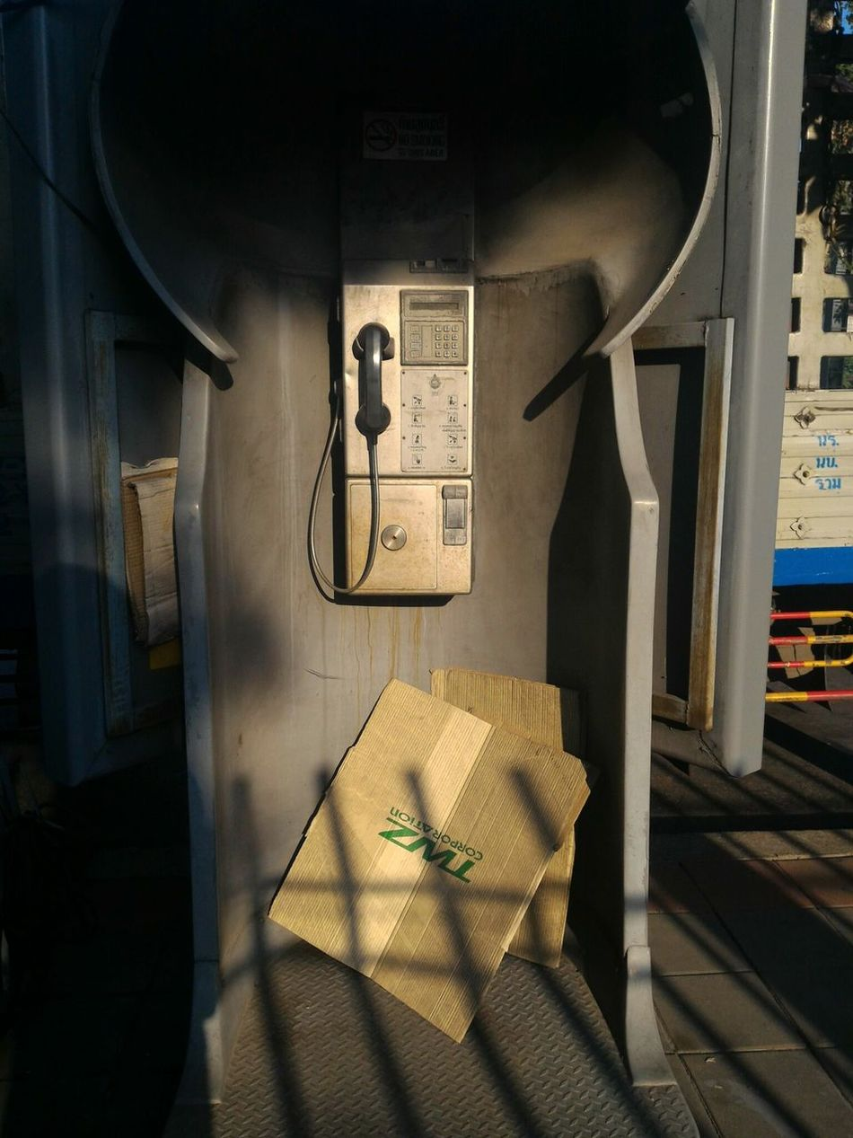 Vintage Phone Telephone Box Past Times  Outmoded Antiquated Technology Moments Of Life Vending Machine Public Places Day No People Outdoors The City Light Sunlight And Shadow Recall