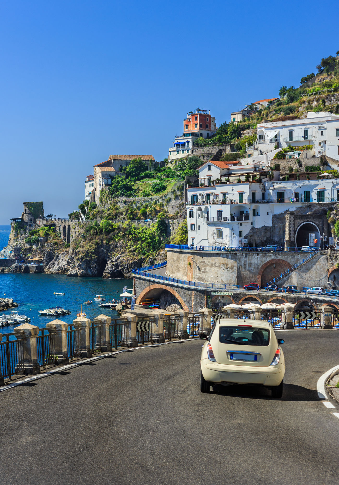 Atrani road at Amalfi Coast Architecture Blue Building Built Structure Canal City City Life Clear Sky Day Diminishing Perspective Mode Of Transport No People Outdoors Parking Residential Building Residential District Road Sky The Way Forward