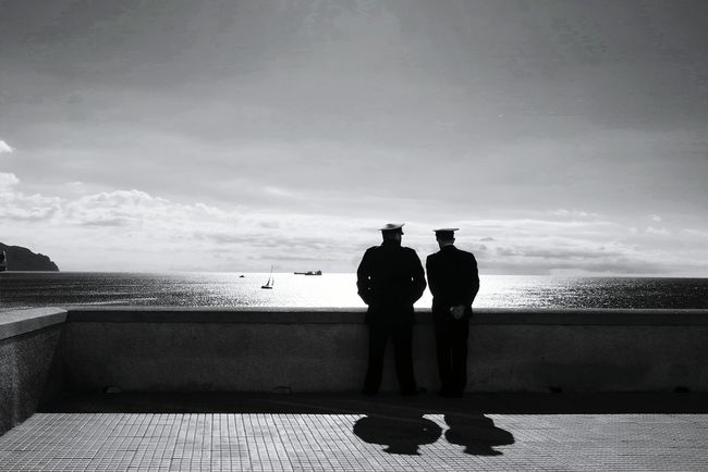 Two Rear View Sea Water Full Length Standing Horizon Over Water Men Sky In Front Of Day Paving Stone Tranquility Nature Tranquil Scene Cloud - Sky Scenics Footpath Vacations Solitude Monochrome Photography Black And White Photography Eye4photography  TakeoverContrast Open Edit Tranquility