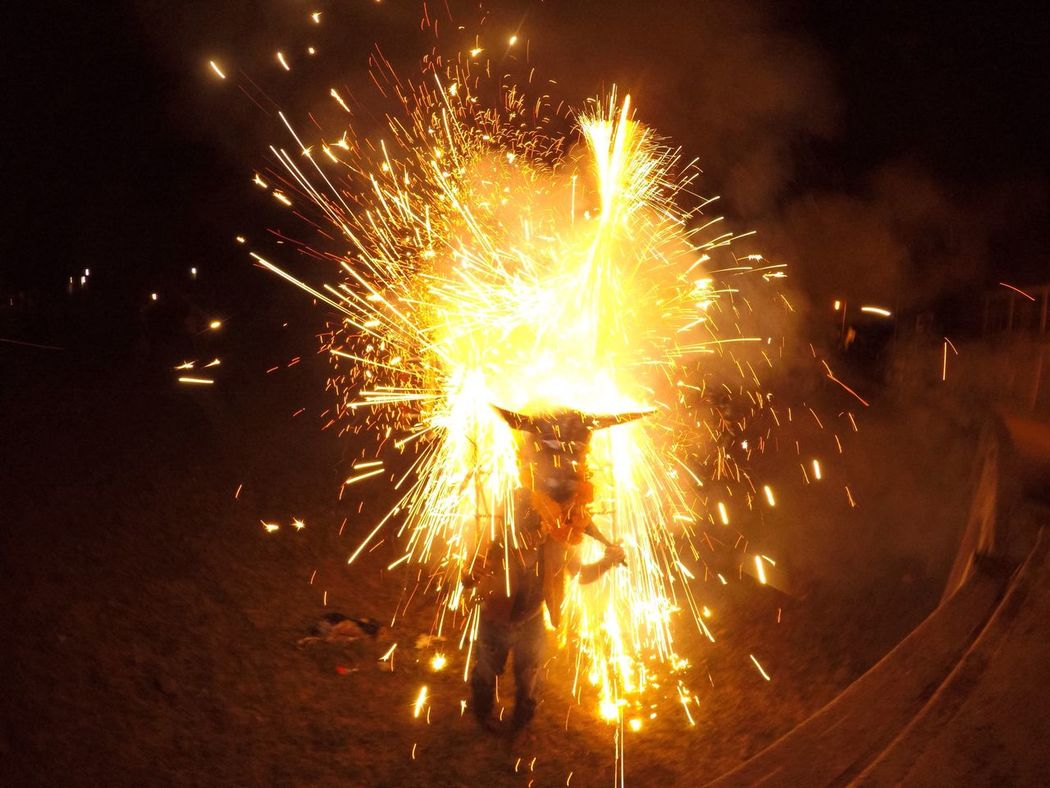 Toritos de trueno Celebration Night Glowing Sparks Motion Outdoors Firework - Man Made Object Firework Display Long Exposure Lifestyles Arts Culture And Entertainment Blurred Motion Exploding Illuminated Yellow Burning Heat - Temperature Sparkler Real People Firework Mexico