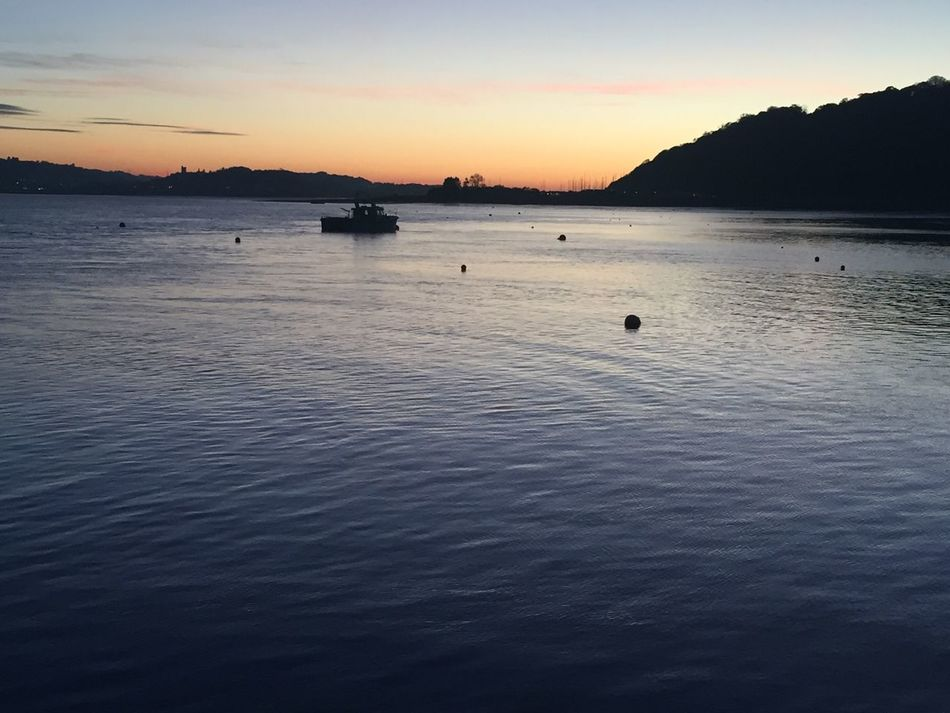 Water Sunset Beauty In Nature Nature Tranquility Waterfront Nautical Vessel Sky Scenics Outdoors Mode Of Transport No People Sea Floating On Water Day