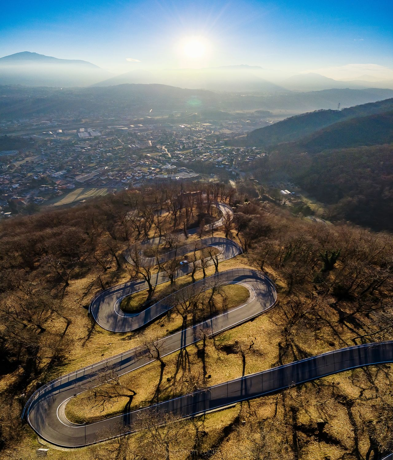 Snaky Road Sky Outdoors No People Nature Scenics Day Road Roads Roadscenes Downhill Curves Hill Hillside Mountain Valley Car Motorcycle Travel Discover  Aerial View Aerial Shot Vertorama Panorama