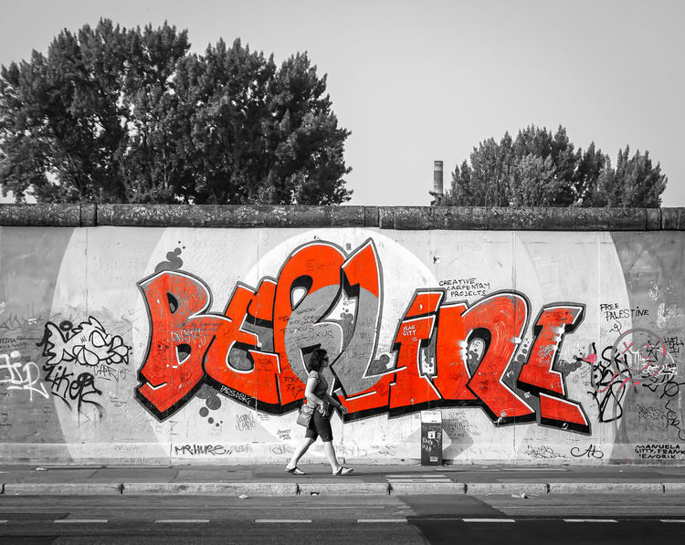 Berlin Photography EyeEm Best Edits Graffiti Red Text Wall Wallking Woman Art Berliner Ansichten Colorkey Communication Day East Side Gallery Famous Place Graffiti Graffiti Art Keycolor No People One Person Orange Color Outdoors Krull&Krull Images Colorkey Text Tree