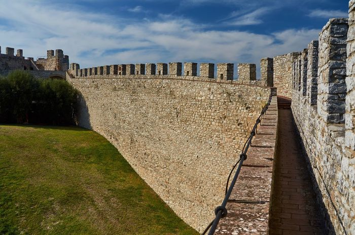 Fortress of the Lion, Castiglione del Lago, Umbria Medieval Nature No People Outdoors Historical Building Italy Umbria Castiglione Del Lago Building Exterior Built Structure Wall Architecture Fortress Wall Historic Fort Fortress Blue Sky Stone Grass Trees