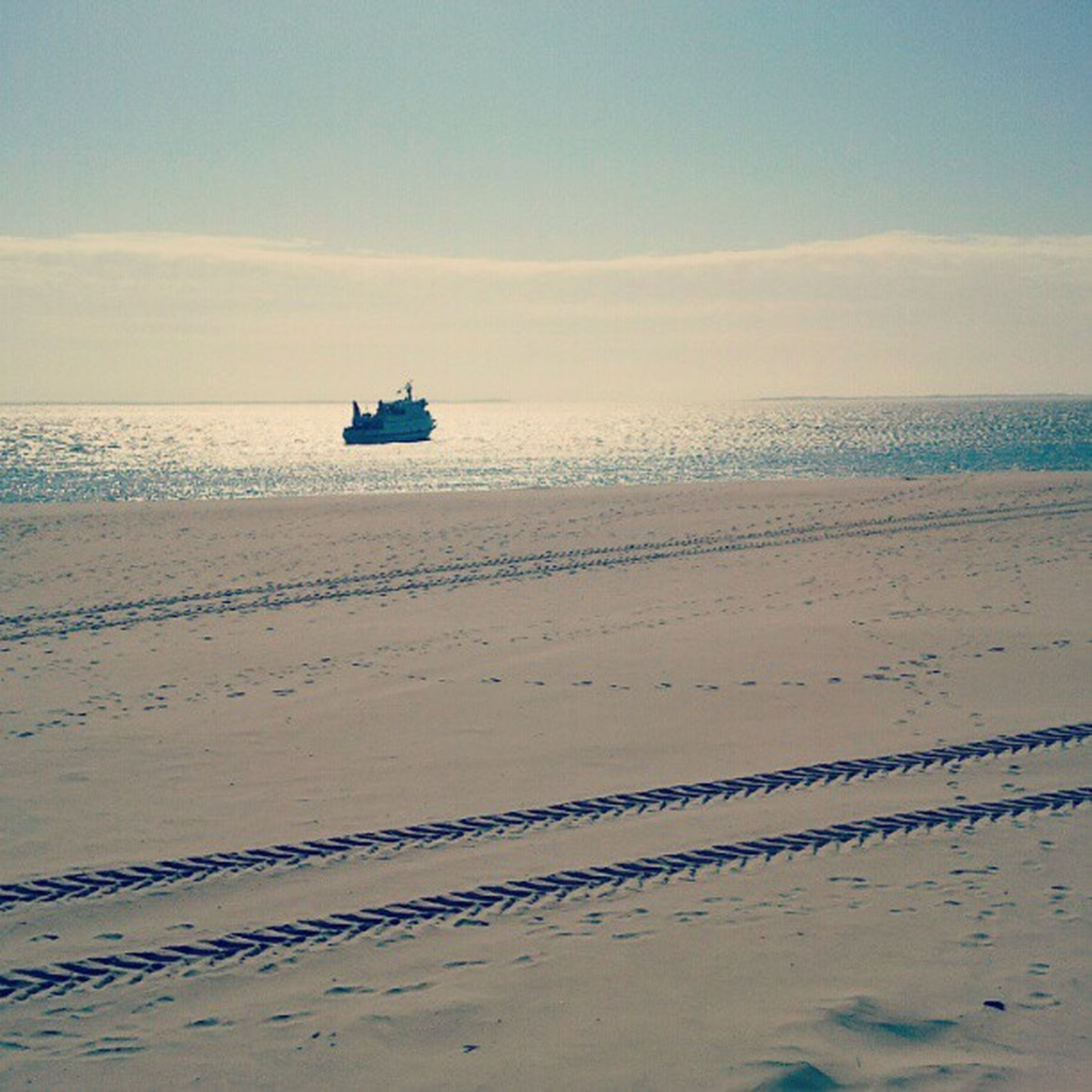 sea, beach, sand, horizon over water, water, shore, sky, tranquility, tranquil scene, transportation, scenics, beauty in nature, nature, nautical vessel, mode of transport, idyllic, outdoors, incidental people, boat, coastline