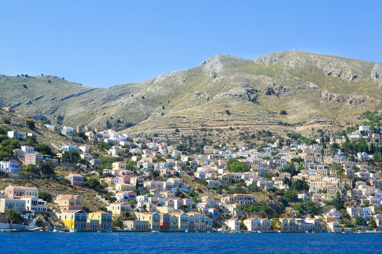 Panoramix view at the beautiful town of Symi, at Symi island, in Greece Architecture Church Colorful Dodecanese Family Vacation Greece Greek Islands Harbor Hill Nature Nature_collection Orthodox Perfect Summer Summer Holidays Sunny Symi  Symi Town Symi ısland Travel Travel Destinations Yacht Yacht Destination
