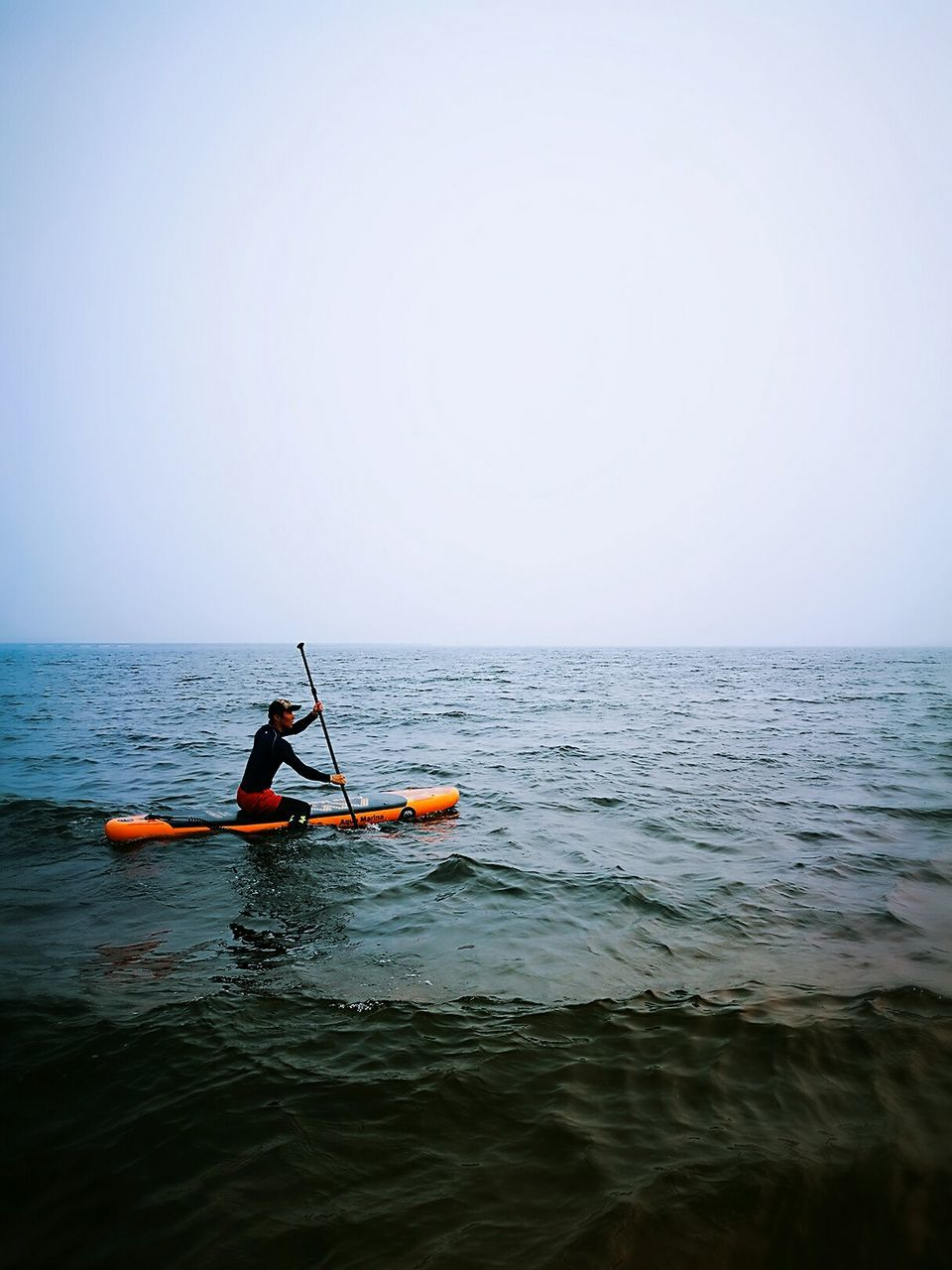 sea, water, oar, horizon over water, copy space, one person, men, outdoors, transportation, nature, nautical vessel, scenics, real people, sitting, day, adventure, clear sky, kayak, one man only, rowing, sky, beauty in nature, adult, only men, people, adults only