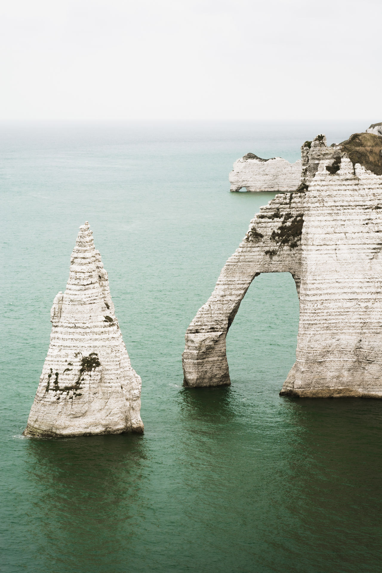 Etretat cliffs, southern view. Kinda old looking, right? Beach Beauty In Nature Cliffs Cliffs And Water Elephant Nature Sculpture Horizon Over Water Landscape Mother Natures Artwork Nature Crafts Normandie France Old School Looking Rock - Object Rocky Coastline Scenics Sea Sky Tranquility Vintage Photo Water