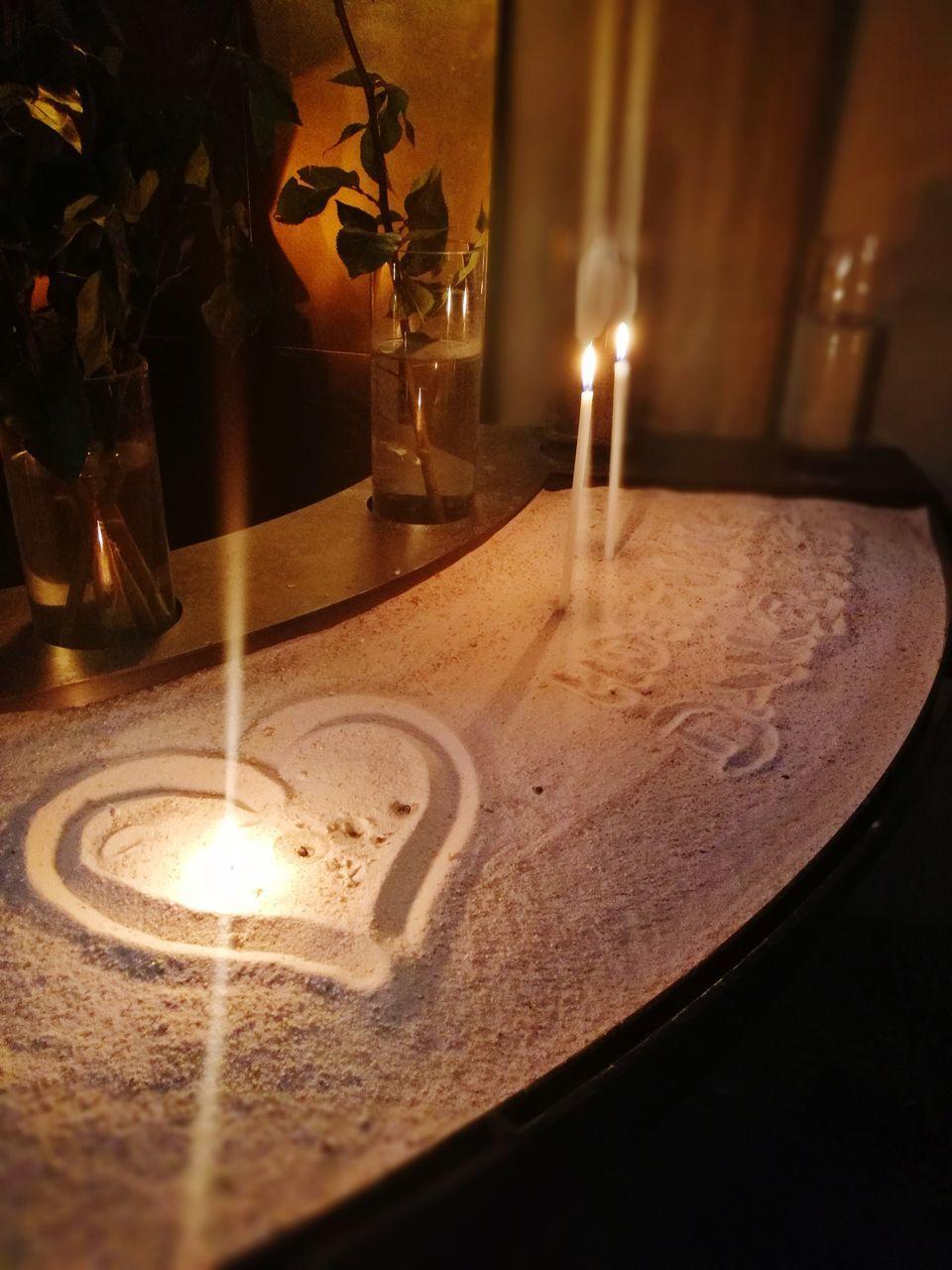 candle, flame, burning, heat - temperature, indoors, glowing, table, illuminated, tea light, no people, close-up, oil lamp, night, diya - oil lamp