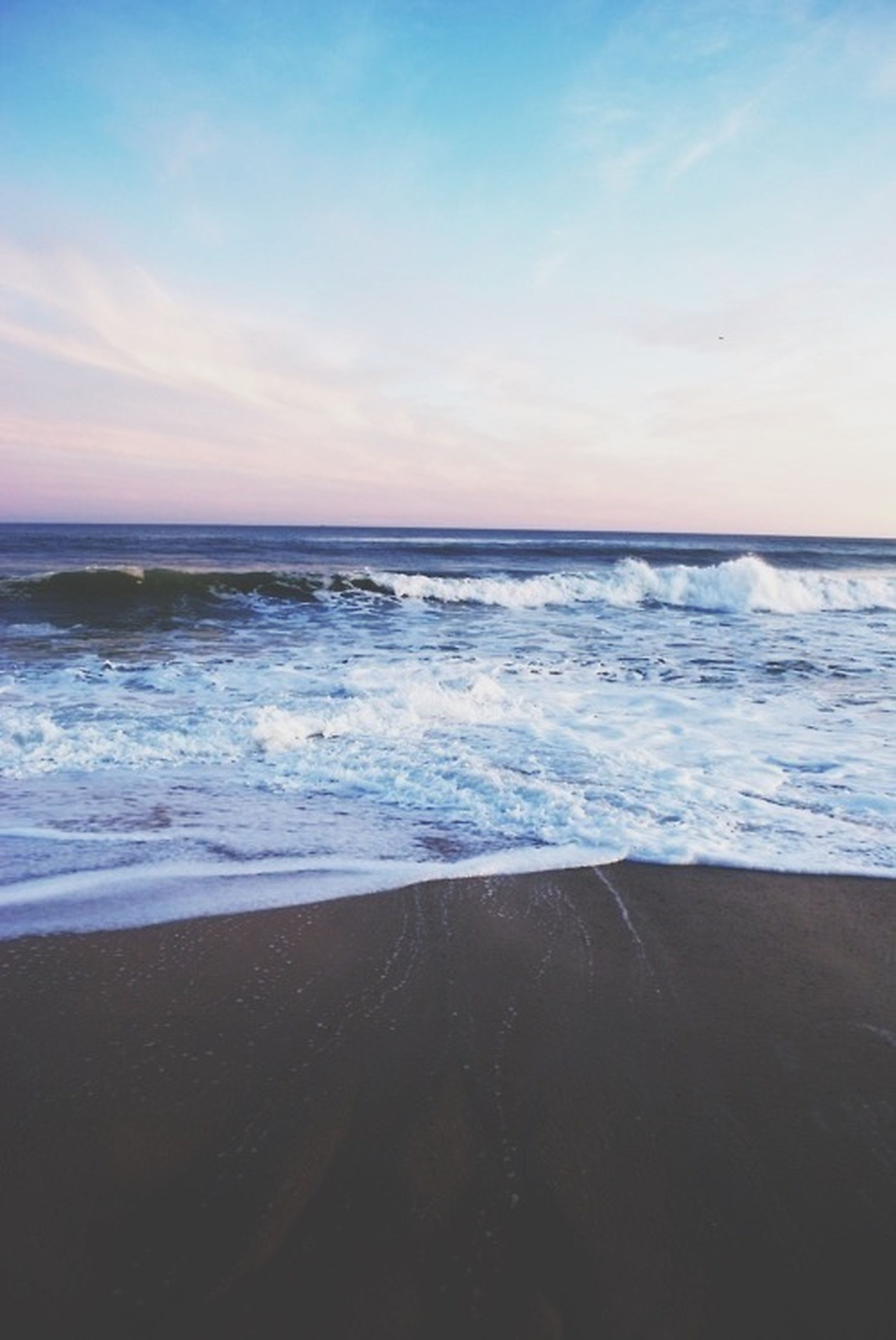 sea, horizon over water, water, beach, wave, scenics, shore, beauty in nature, sky, tranquil scene, tranquility, surf, nature, sand, idyllic, seascape, motion, sunset, outdoors, remote
