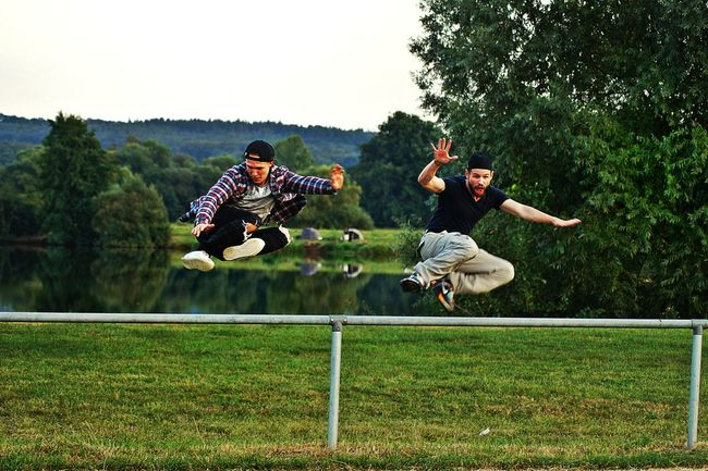 People And Places Friends Two Young Men Outdoors Sportive ActivityFun Nature Jumping Up On The Lakeshore Lakeview | Chicago Growth Freshness Green Color Plant Beauty In Nature Leisure Activity Lifestyles Casual Clothing Togetherness Kinzigsee Langenselbold Germany🇩🇪