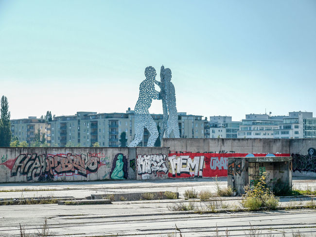 Berlin, view towards Kreuzberger Ufer, Melecule Men Art And Craft Berlin Built Structure Capital Cities  Cityscapes Clear Sky Day Graffitty Kreuzberg Molecule Man Monument No People Outdoors Sculpture Travel Destinations Urban Landscape Urban Scenery The Great Outdoors - 2016 EyeEm Awards