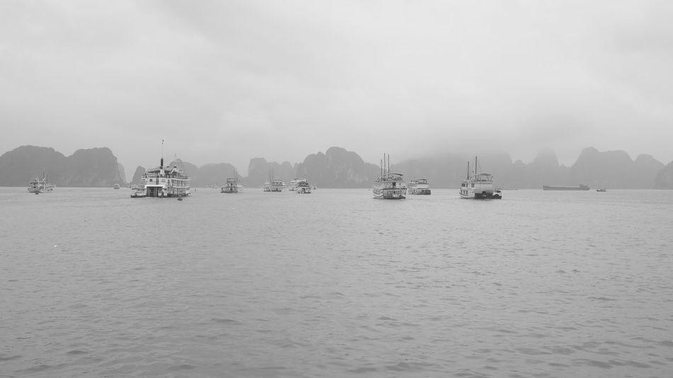Ha Long Black & White Black And White Blackandwhite Boat Fog Foggy Ha Long Ha Long Bay Harbor No People Rocks Sea Ship Tourism Transportation Vietnam Water Waterfront