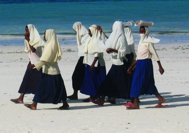 2006 Beach Books Cultures Day Full Length Outdoors Real People Sand School Uniforms Around The World Seaside_collection Shadows Sunlight Togetherness Walking Together White And Blue Uniform Zanzibar