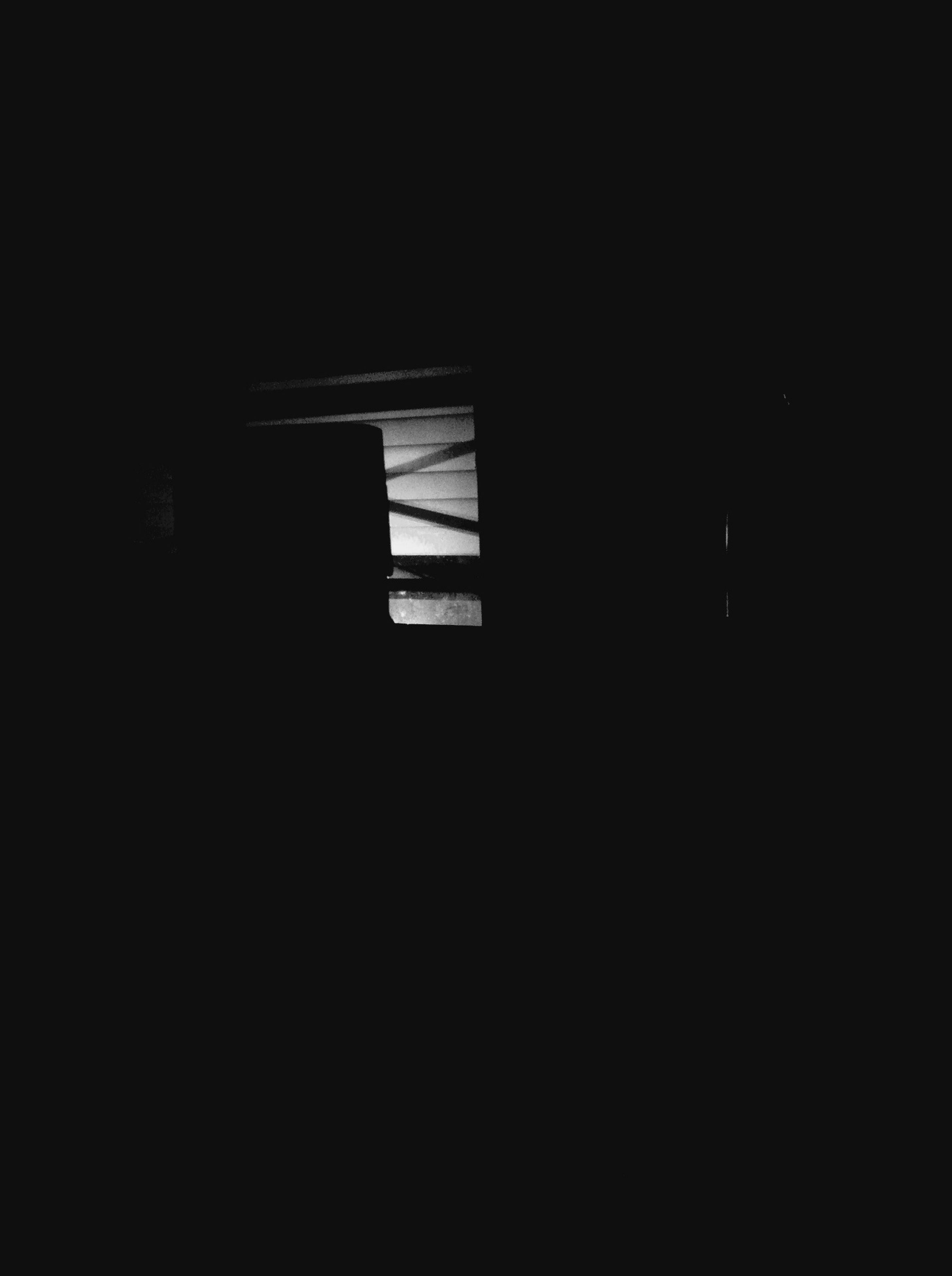 dark, copy space, night, built structure, architecture, window, low angle view, indoors, illuminated, no people, building exterior, clear sky, building, silhouette, house, wall - building feature, light - natural phenomenon, darkroom, shadow