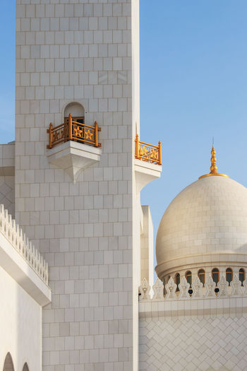 Abu Dhabi, United Arab Emirates - October 10,2014: Domes of the Sheikh Zayed Grand Mosque at sunset Abu Dhabi Arabic Architectural Feature Architecture Blue Building Exterior Built Structure Clear Sky Day Dome Façade Faith Famous Place Historic History Islam Mosque Outdoors People Place Of Worship Religion Sheik Zayed Mosque Spirituality United Arab Emirates White Mosque