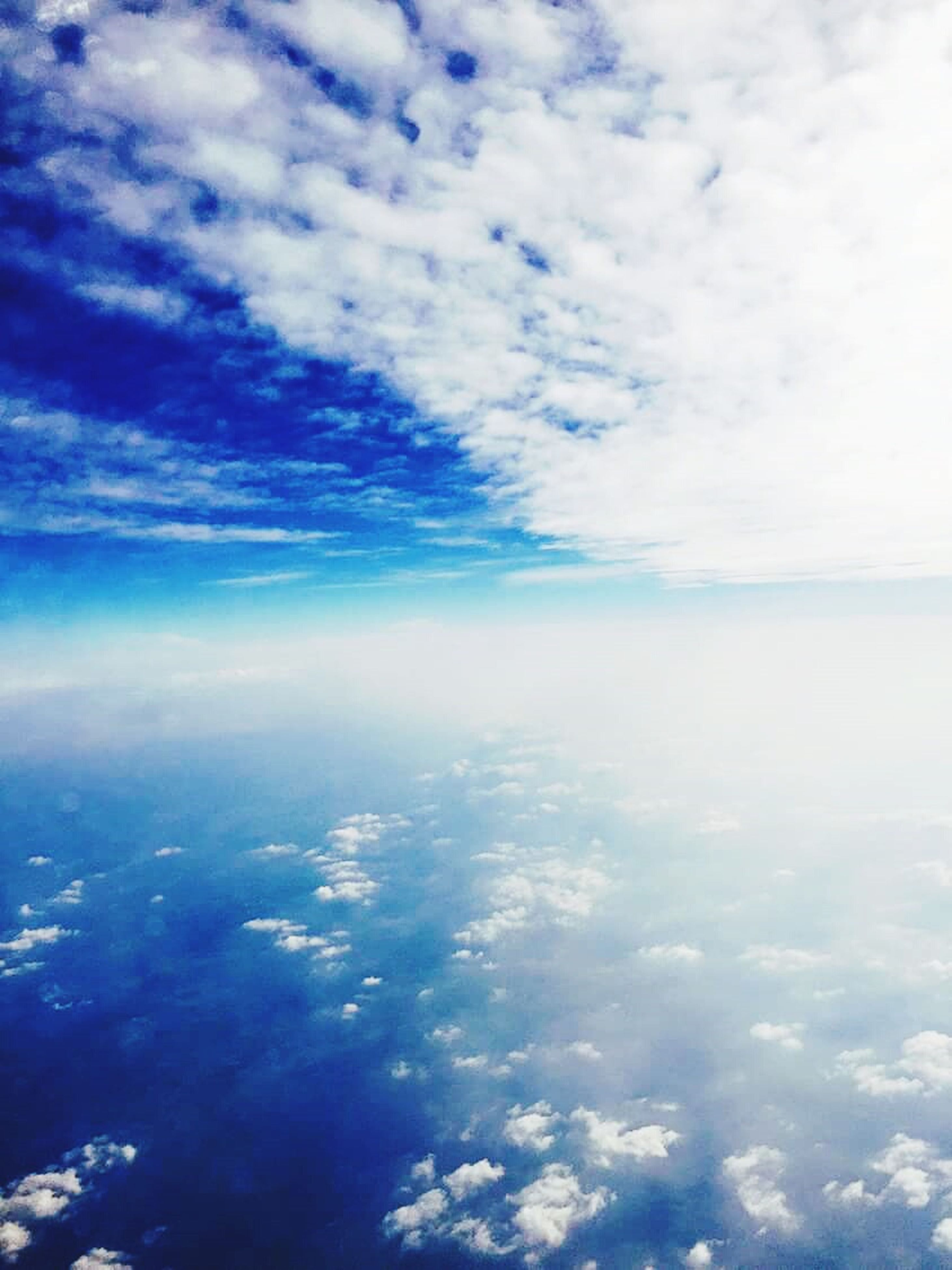 sky, scenics, beauty in nature, tranquil scene, tranquility, cloud - sky, nature, blue, cloudy, cloud, idyllic, sea, cloudscape, water, day, outdoors, backgrounds, white color, no people, aerial view