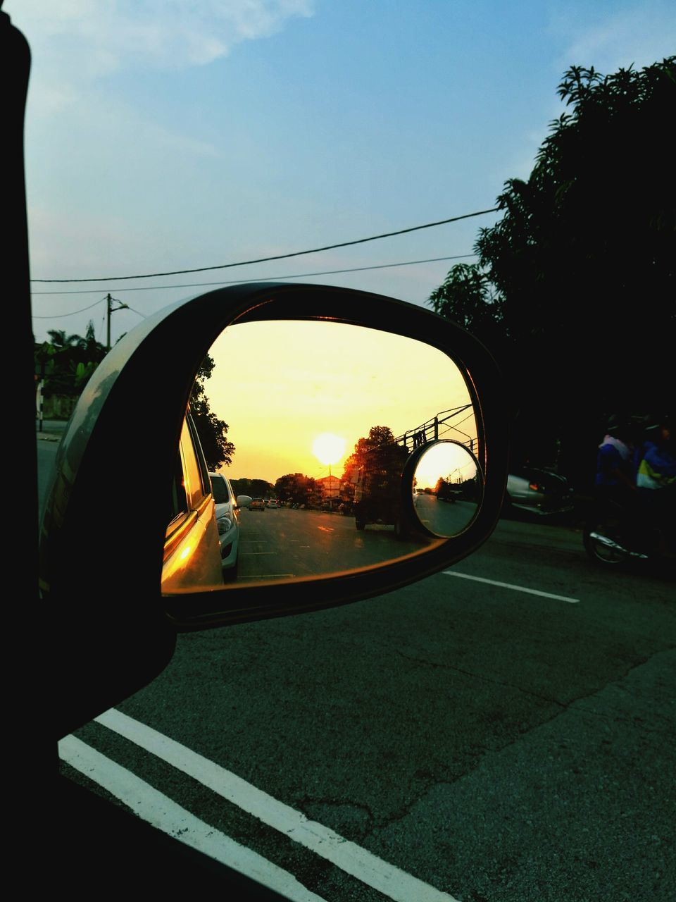 transportation, side-view mirror, car, mode of transport, land vehicle, sky, tree, road, outdoors, day, one person, nature, people