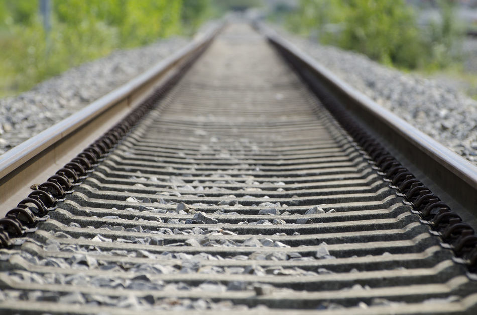 Railroad tracks. Close-up Connection Day Detail Diminishing Perspective Focus On Foreground Low Angle View Mode Of Transport Nature No People Outdoors Railroad Track Railway Track Selective Focus Straight Surface Level The Way Forward Tranport Tranquility Vanishing Point