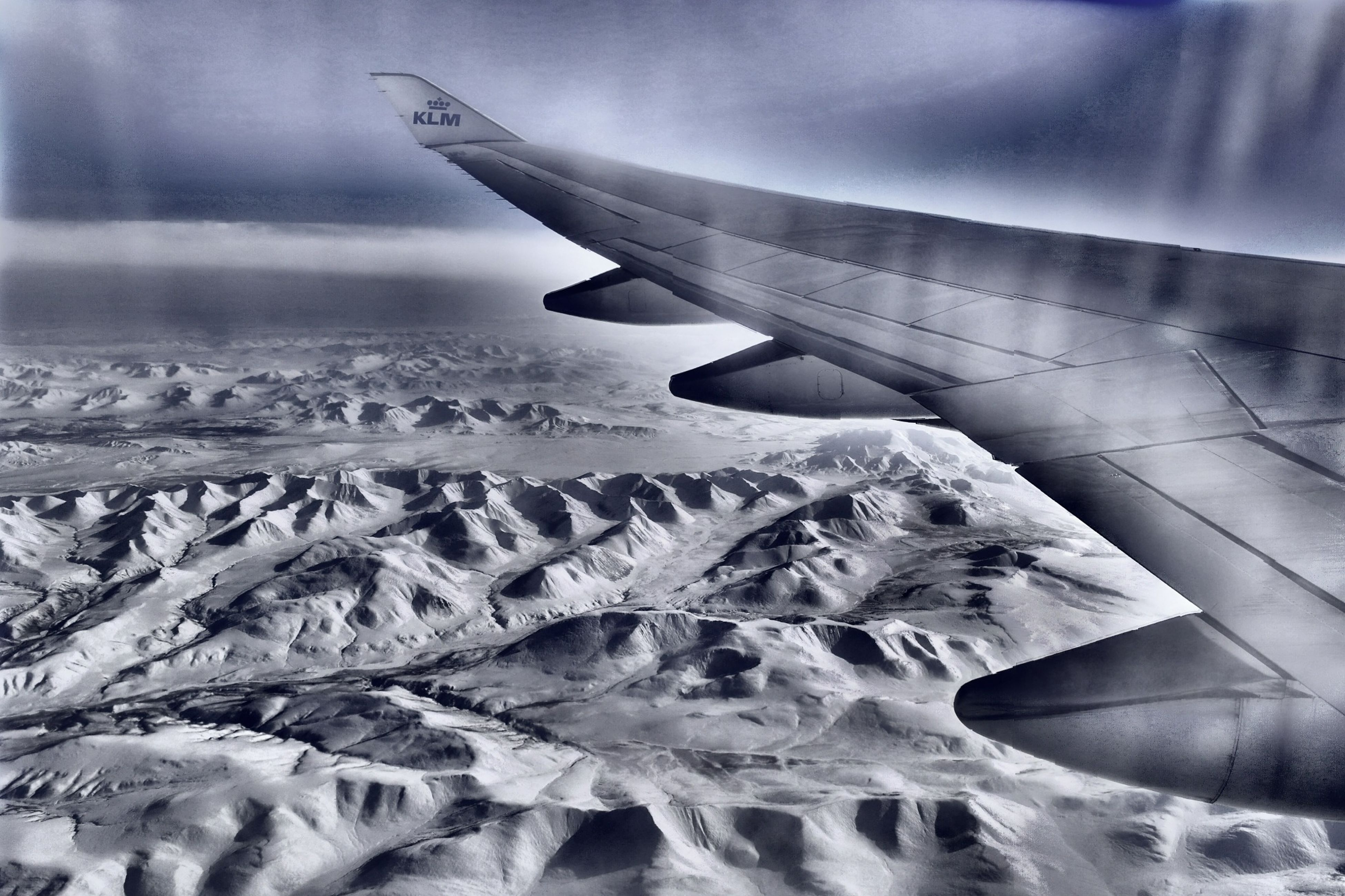 aircraft wing, airplane, flying, air vehicle, aerial view, part of, cropped, transportation, mode of transport, snow, winter, sky, landscape, travel, cold temperature, nature, scenics, mid-air, journey, beauty in nature