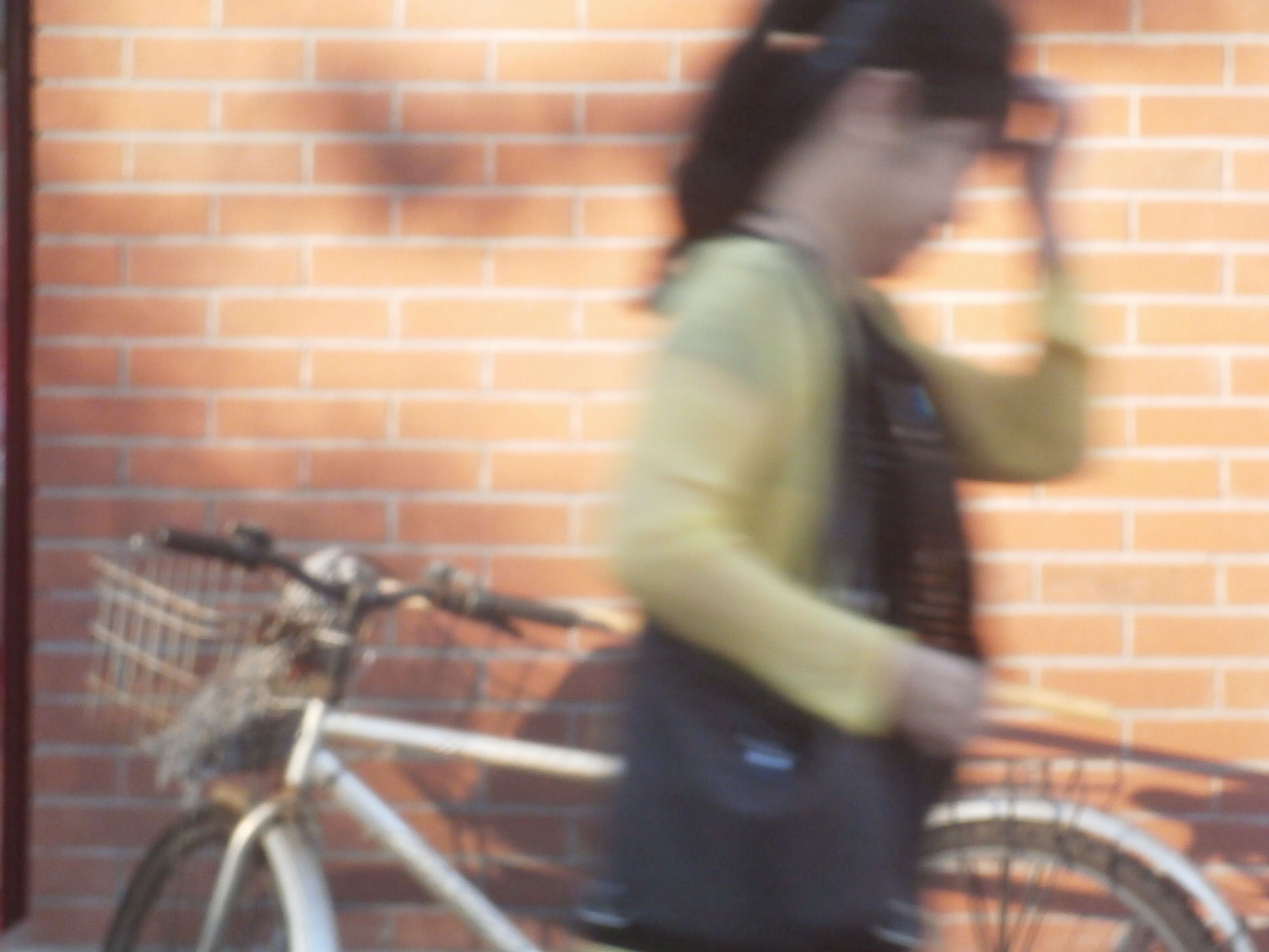 blurred motion, bicycle, men, transportation, lifestyles, walking, on the move, motion, street, wall - building feature, railing, leisure activity, cycling, land vehicle, riding, person, outdoors, city life