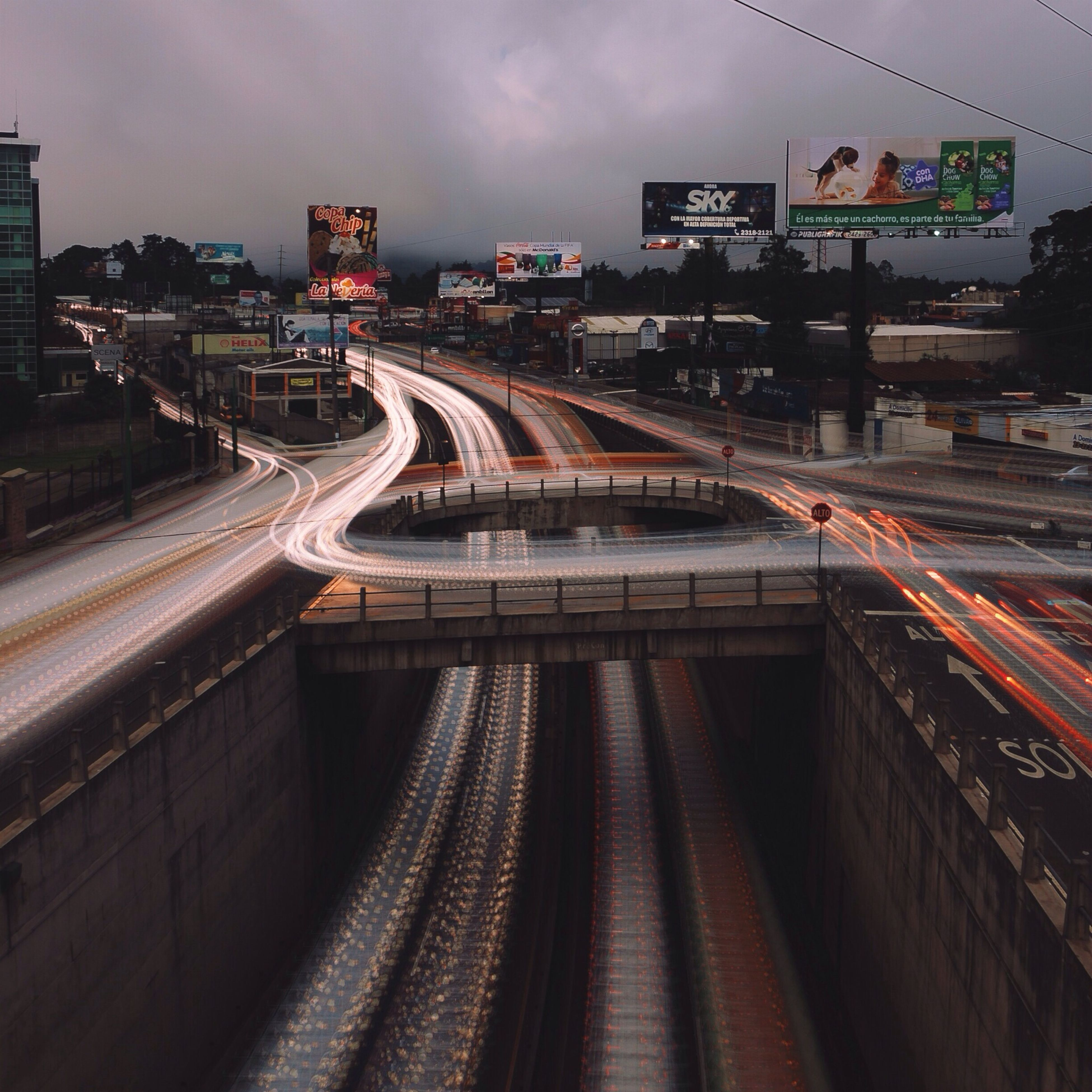 transportation, illuminated, public transportation, railroad track, rail transportation, railroad station platform, railroad station, architecture, built structure, travel, train - vehicle, high angle view, mode of transport, speed, connection, night, bridge - man made structure, passenger train, train, motion