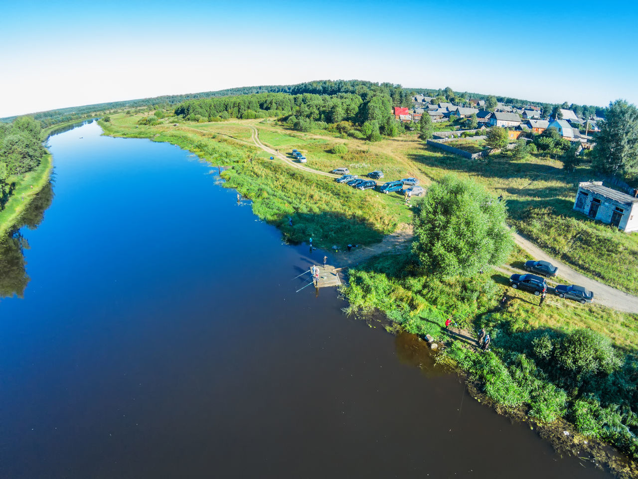 Aerial view of the fishermen in the river Mologa A Bird's Eye View Aerial Aerial View Beauty In Nature Clear Sky Environment Green Color Lake Landscape Mologa Nature Outdoors River Rural Scene Scenics Sky Top Perspective Tourism Tranquility Travel Destinations Tree Urban Skyline Vacations Water
