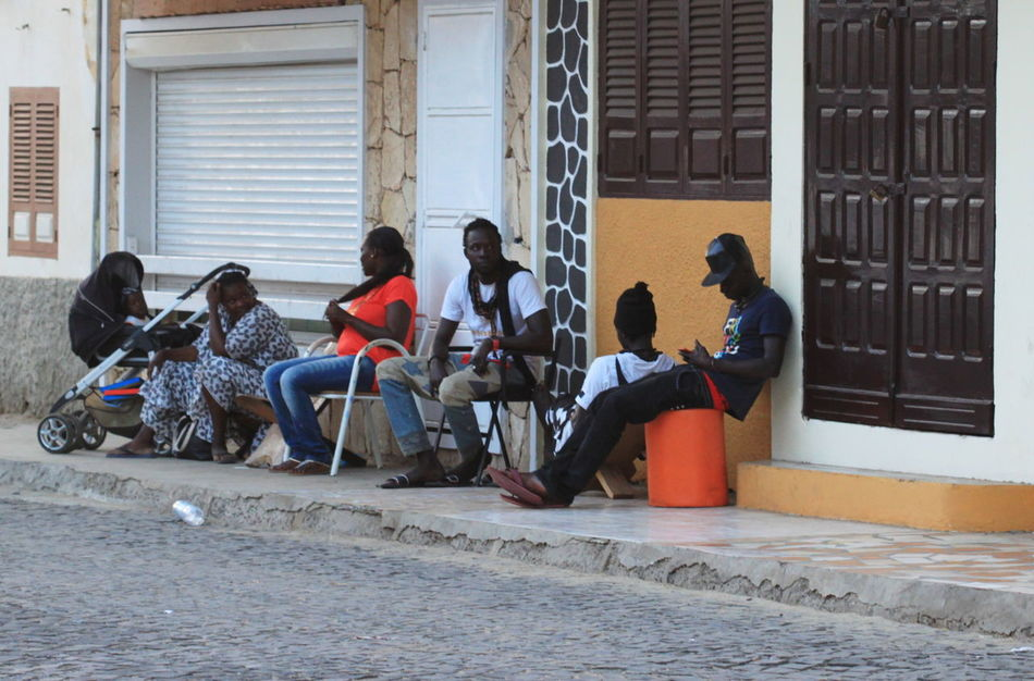 Architecture Building Exterior Built Structure Capo Verde City Day Full Length Lifestyles Medium Group Of People Men Outdoors Real People Sal Island Santa Maria Sitting Street Photography Summer 2015 Togetherness Women