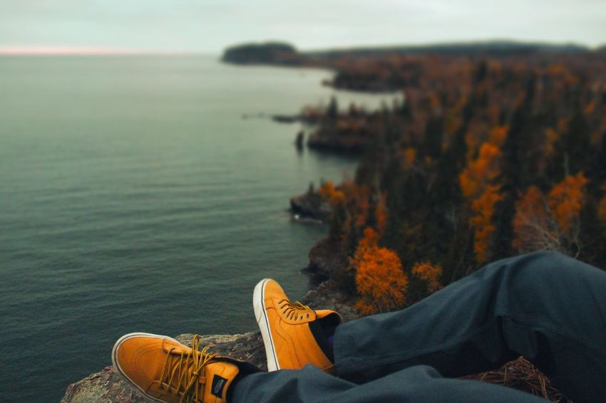 Sitting Outdoors Nature One Person Water Beauty In Nature Shoes Vans Fall North Shore Minnesota Duluth Wander Duluth Trading Co Fall Colors Edited First Eyeem Photo