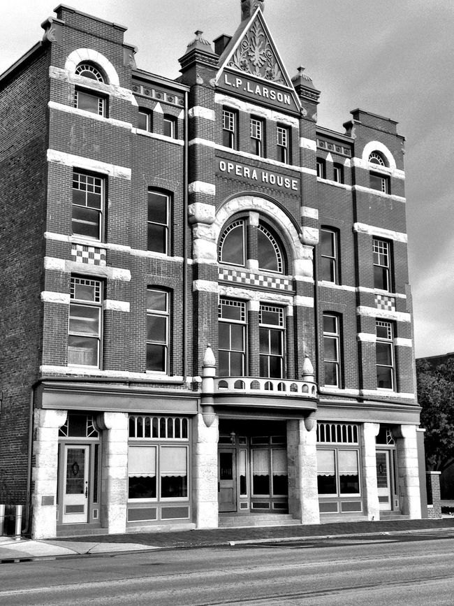 LP Larson Opera House - Fremont, NE The theater was built by James Wheeler Love in 1888. In 1905 it was purchased by L. P. Larson and renamed the L. P. Larson Opera House. The three-story brick and stone building is a landmark in the town of Fremont and is one of the largest remaining opera houses in the state. Arch Architectural Column Architectural Feature Architecture Building Exterior Built Structure City Clear Sky Day Entrance Exterior Façade Historic History Low Angle View No People Old Town Outdoors Past Place Of Worship Sky Window