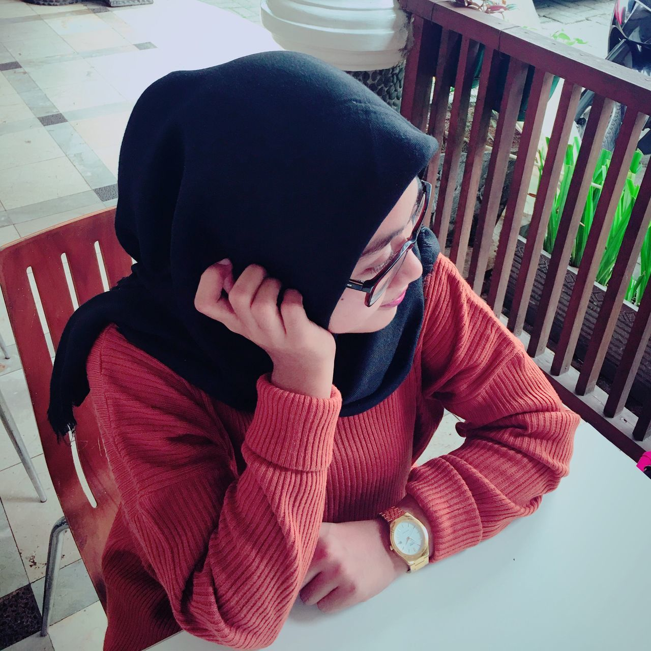 Hijab woman Obscured Face Sitting Young Adult Casual Clothing Relaxation Day Person Red Human Face