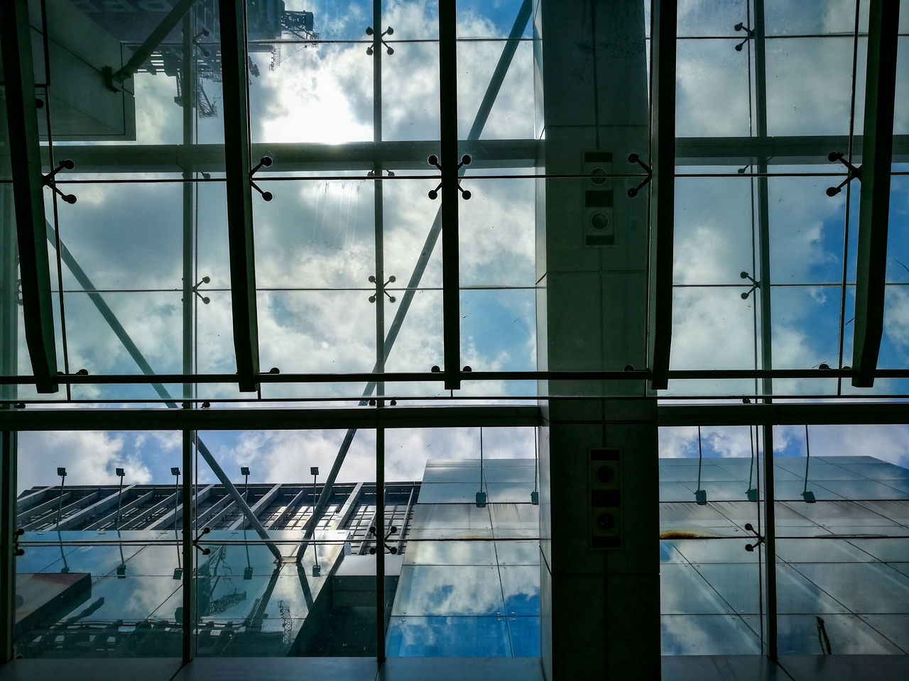 glass - material, window, architecture, indoors, built structure, day, no people, cloud - sky, sky, full frame, close-up