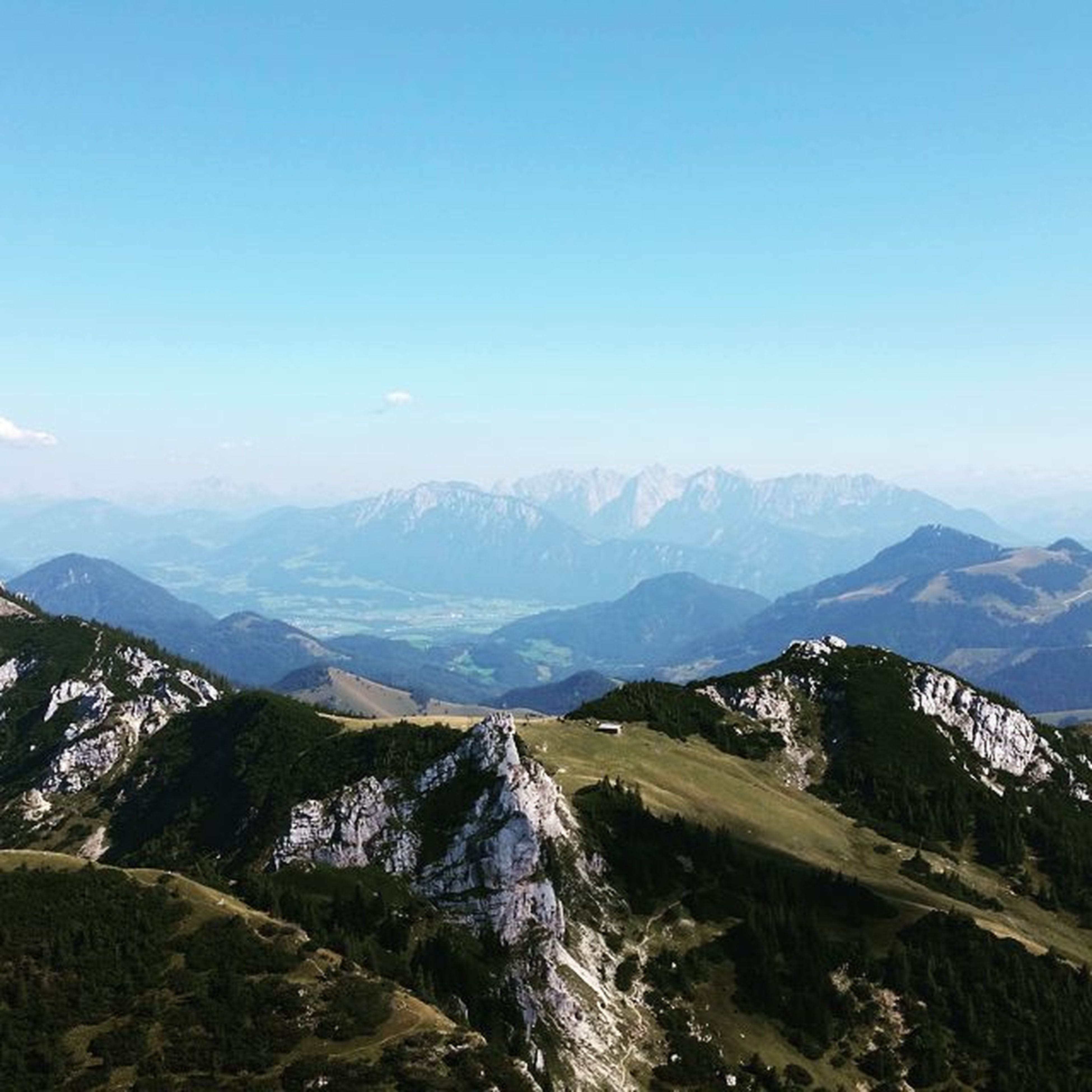 mountain, clear sky, mountain range, tranquil scene, tranquility, scenics, copy space, landscape, beauty in nature, blue, nature, non-urban scene, idyllic, remote, day, tree, outdoors, sky, physical geography, no people