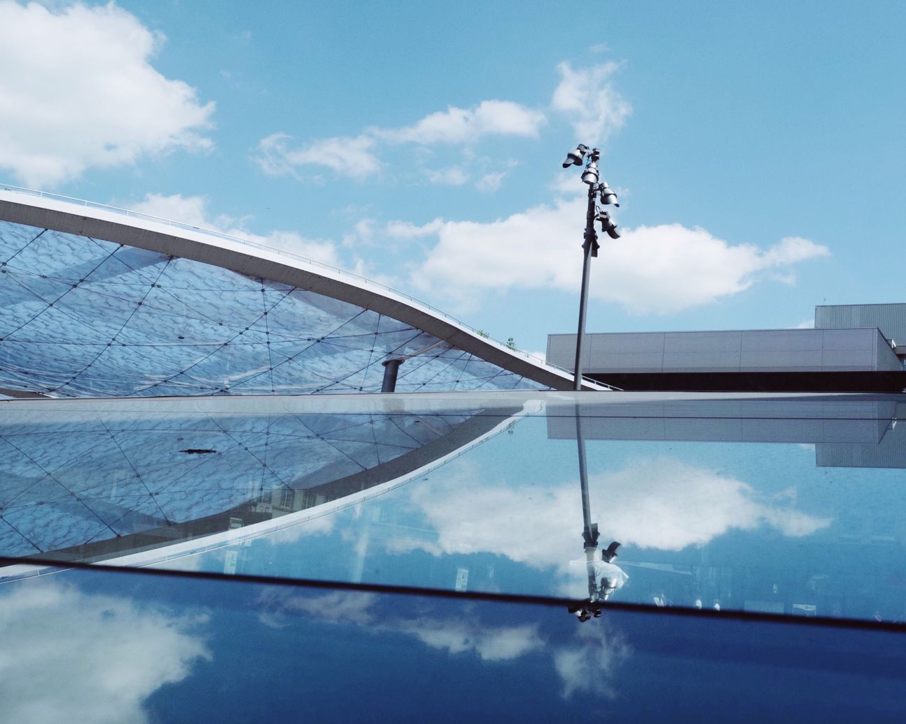 Sky Cloud - Sky Day Reflection Outdoors Low Angle View Blue No People Architecture Built Structure Architecture Blue Sky The Architect - 2017 EyeEm Awards