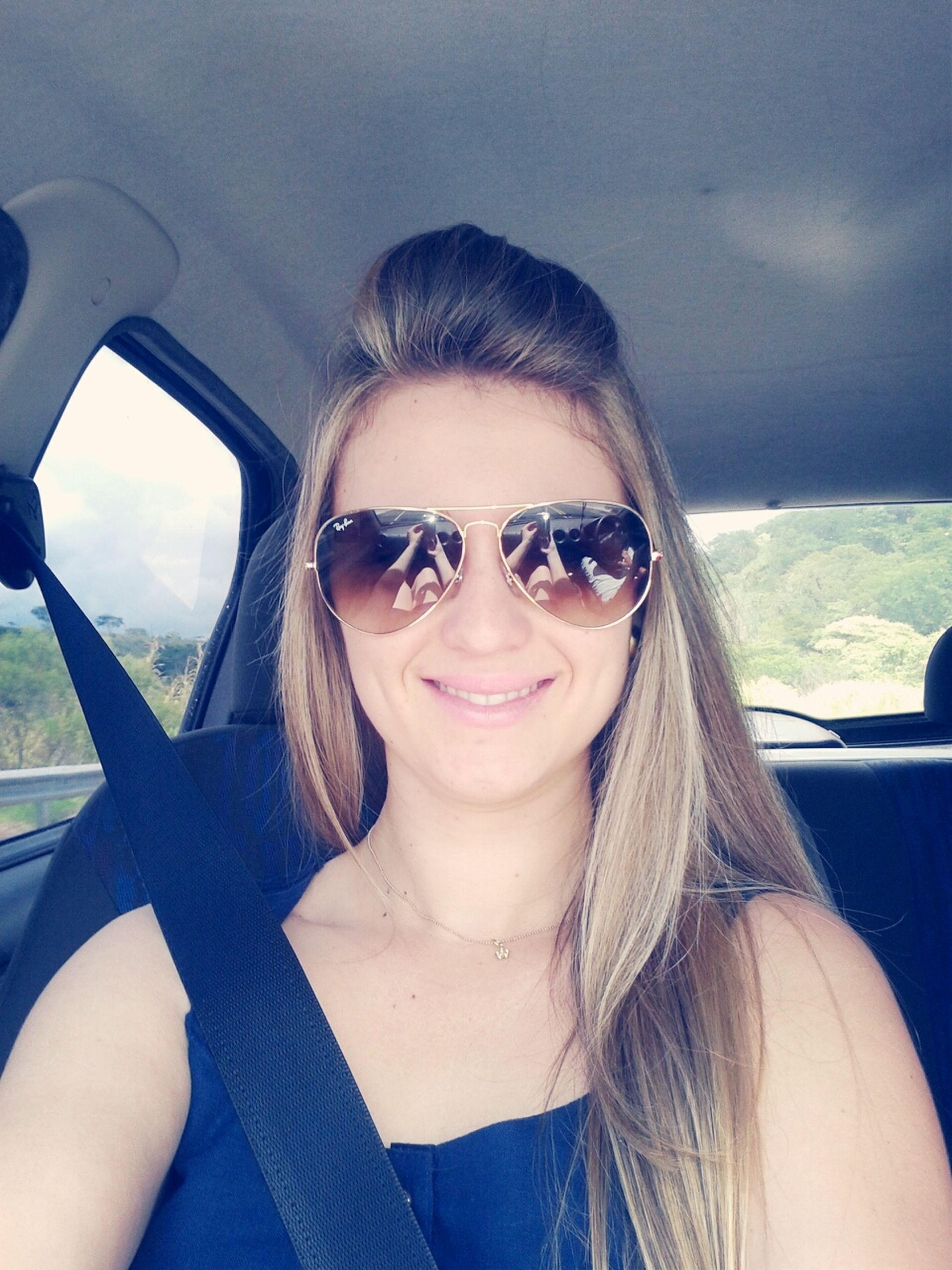 transportation, mode of transport, vehicle interior, sunglasses, young adult, portrait, person, lifestyles, looking at camera, leisure activity, car, travel, headshot, land vehicle, car interior, head and shoulders, young women, sunlight