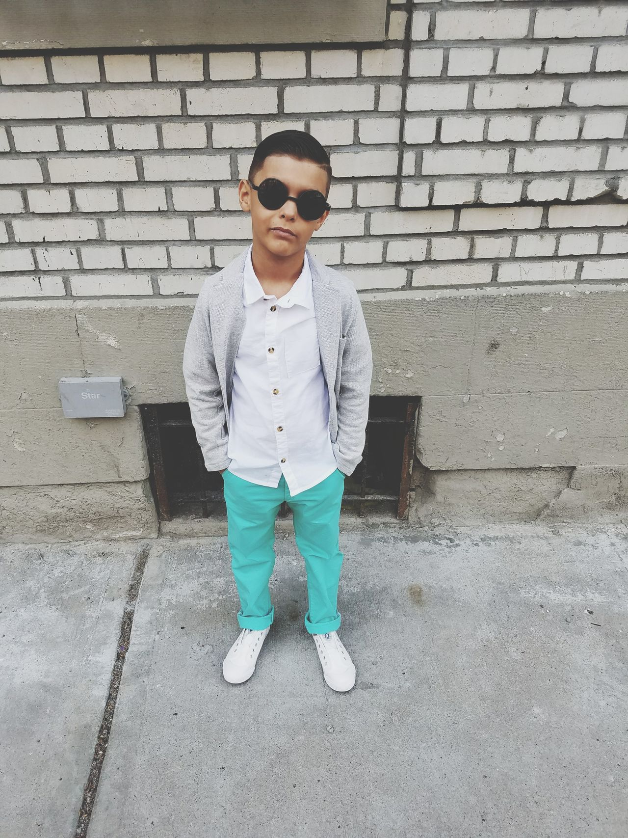 Young boy Sunglasses One Person Casual Clothing Front View Standing Fashion Outdoors Kid Boy Chinos Brick Wall Sidewalk Hipster - Person