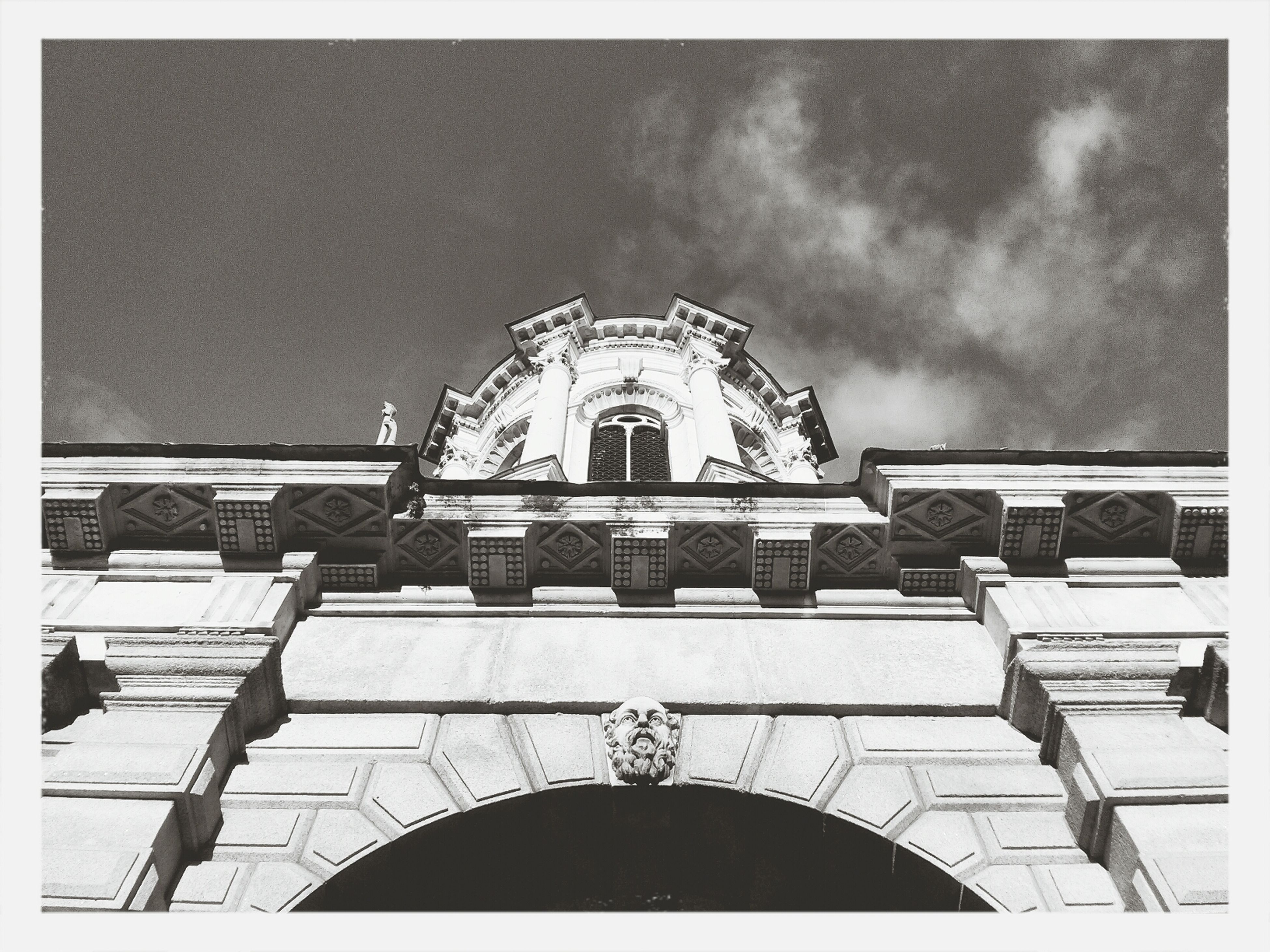architecture, built structure, arch, low angle view, building exterior, transfer print, sky, auto post production filter, building, railing, facade, day, window, cloud - sky, architectural feature, outdoors, no people, cloud, arched, entrance