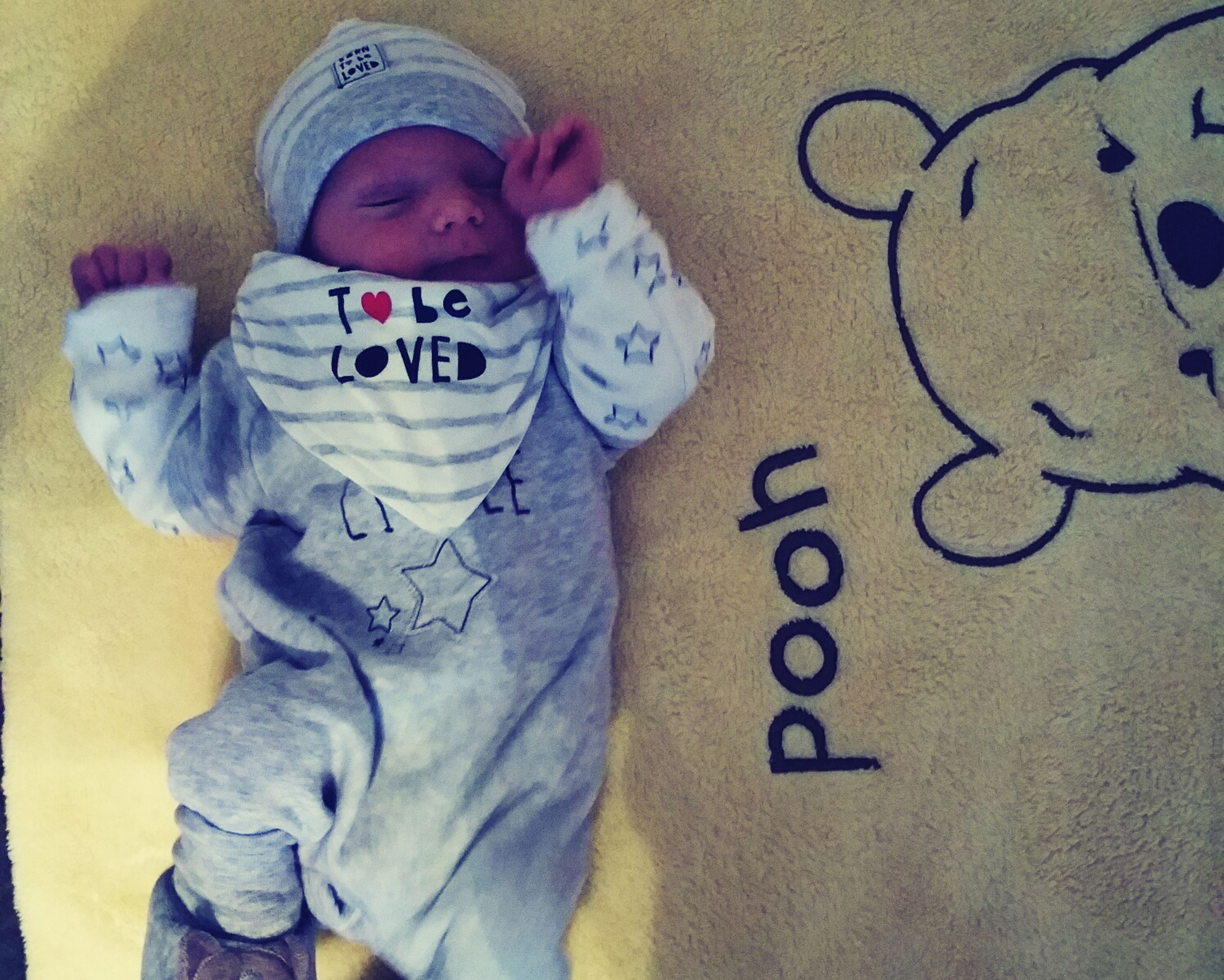 indoors, childhood, text, high angle view, communication, person, innocence, bed, relaxation, baby, cute, babyhood, love, home interior, western script, casual clothing, toddler, boys