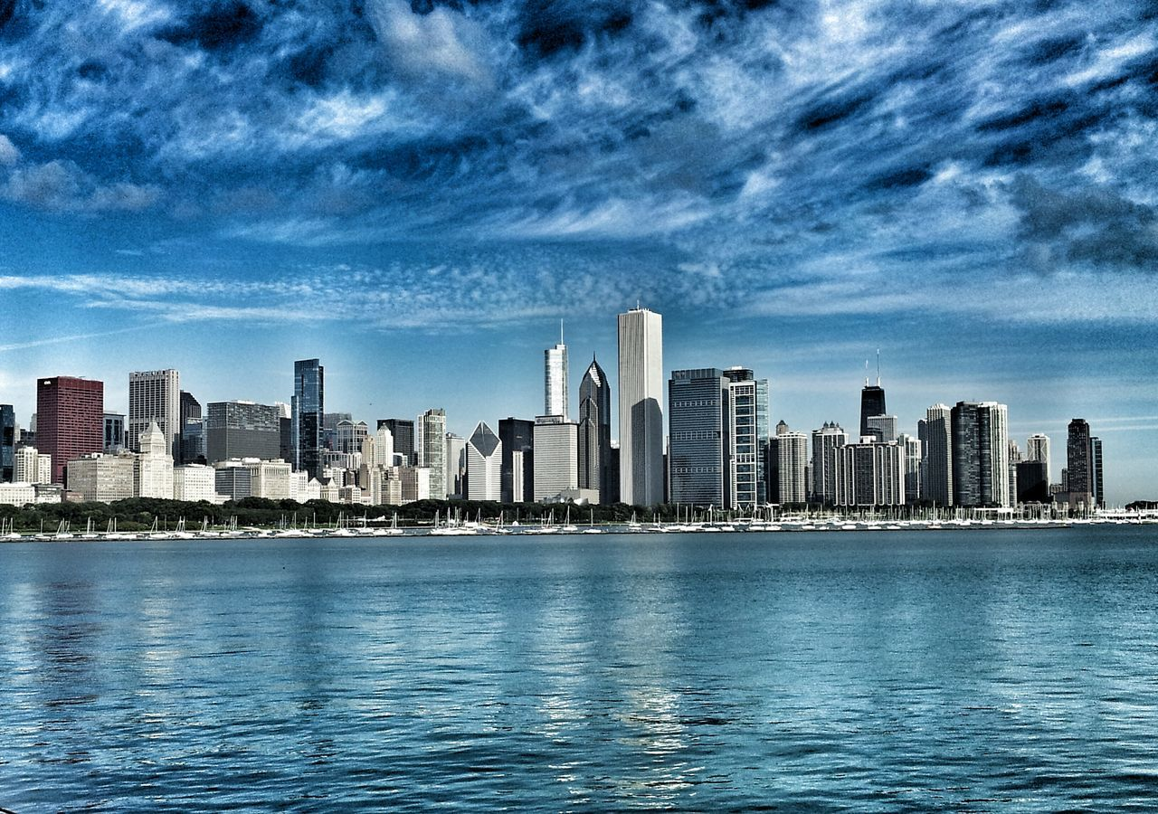 skyscraper, architecture, building exterior, cityscape, waterfront, sky, city, urban skyline, cloud - sky, tower, built structure, water, downtown district, no people, modern, sea, outdoors, day, travel destinations