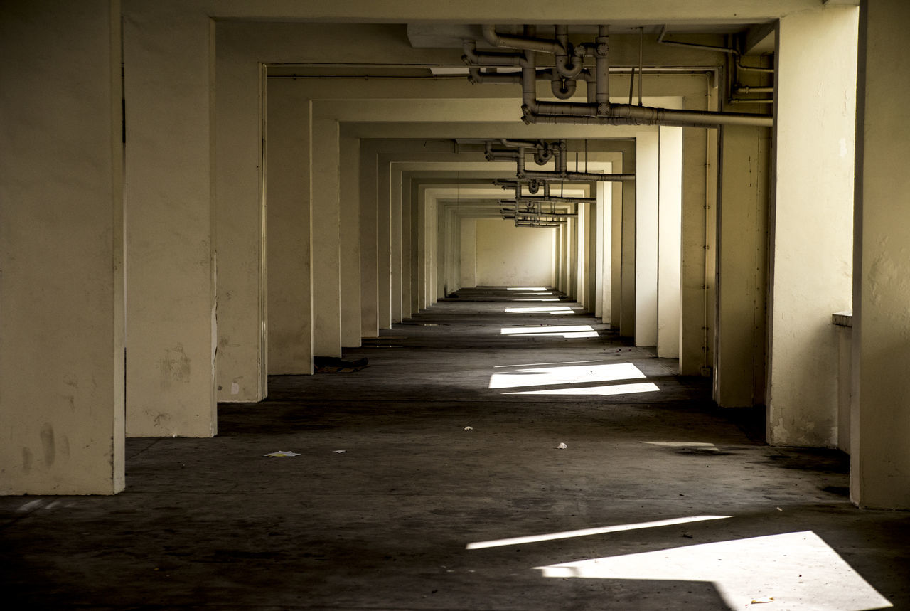 Abandoned Absence Architecture Building Ceiling Composition Corridor Diminishing Perspective Empty Indoors  Leading Narrow Perspective Railing Staircase Steps Steps And Staircases The Way Forward Void Deck Wall