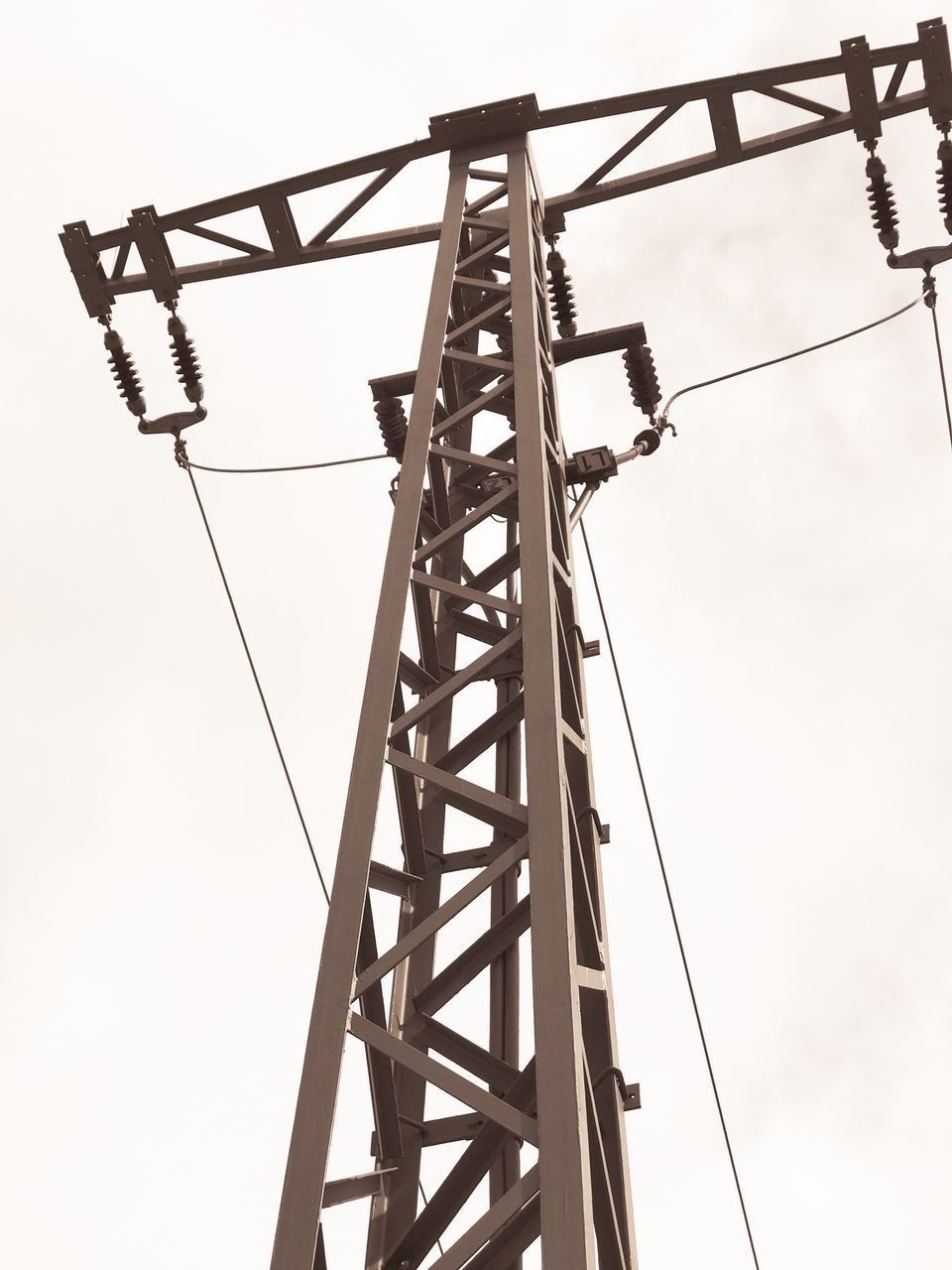 low angle view, metal, connection, cable, day, outdoors, electricity, no people, clear sky, technology, sky, electricity pylon
