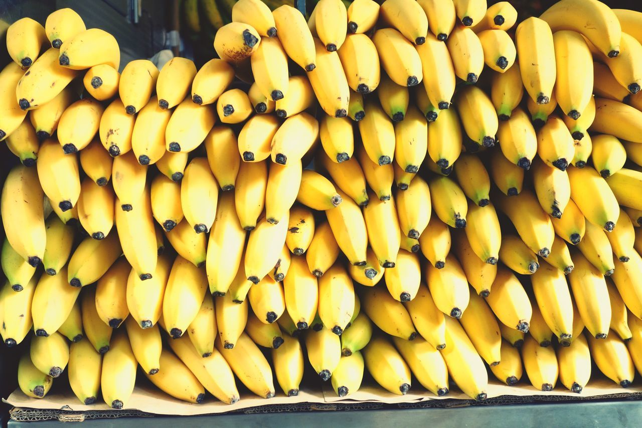yellow, food and drink, abundance, food, large group of objects, stack, outdoors, day, freshness, fruit, healthy eating, for sale, retail, no people, heap, market, close-up, nature