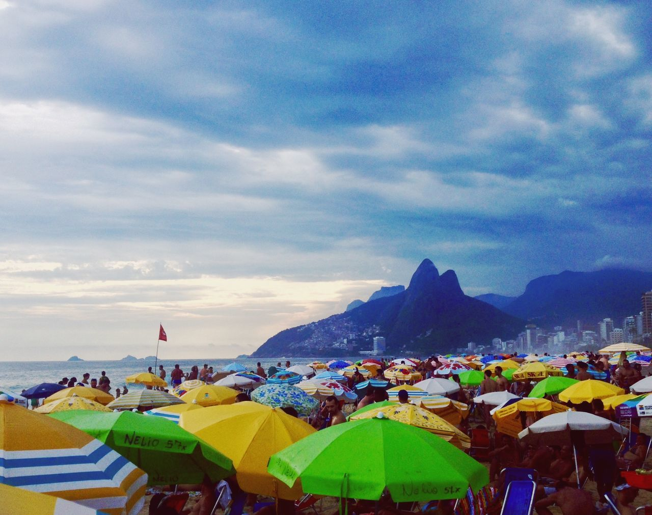 Beautifully Organized Sky Cloud - Sky Nature Beauty In Nature Mountain Camping Scenics Vacations Real People Water Outdoors Beach Day Large Group Of People Ipanema Beach Rio De Janeiro Umbrella