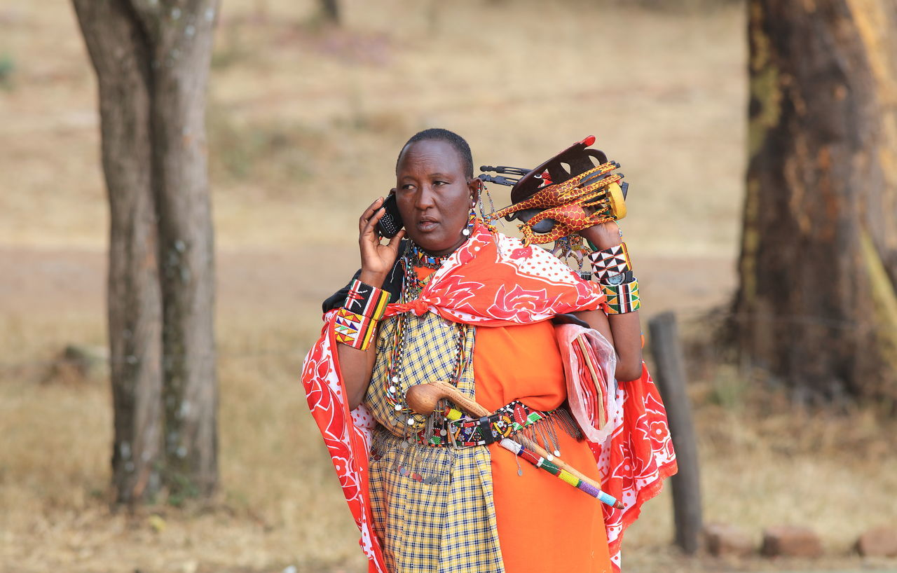 African Beauty African Lady Cultures Gifts Happiness Kenya Lifestyles Maasai Land Maasai Mara National Park Maasai People Maasai Wear Modern Afric Multi Colored Rural Scene Smiling Souvenirs Take Aways