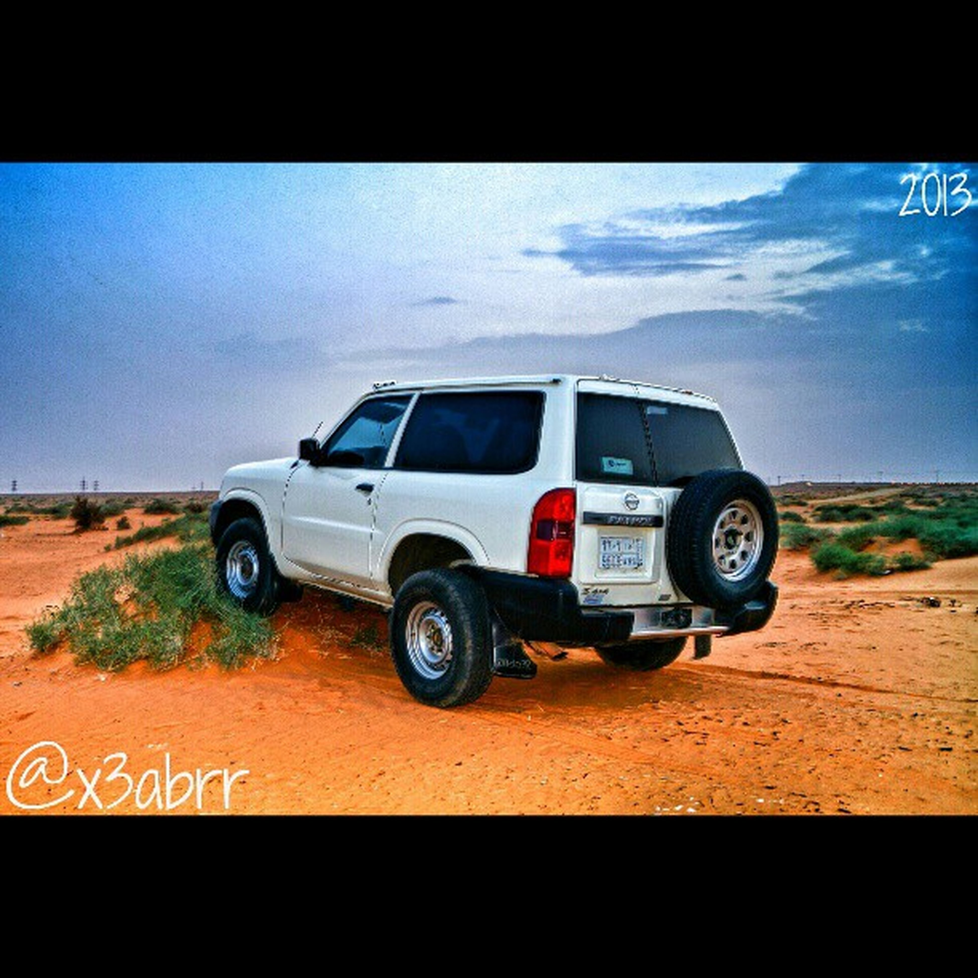transportation, land vehicle, mode of transport, car, transfer print, auto post production filter, sky, road, travel, stationary, street, bicycle, on the move, landscape, field, parked, day, outdoors, cloud, cloud - sky