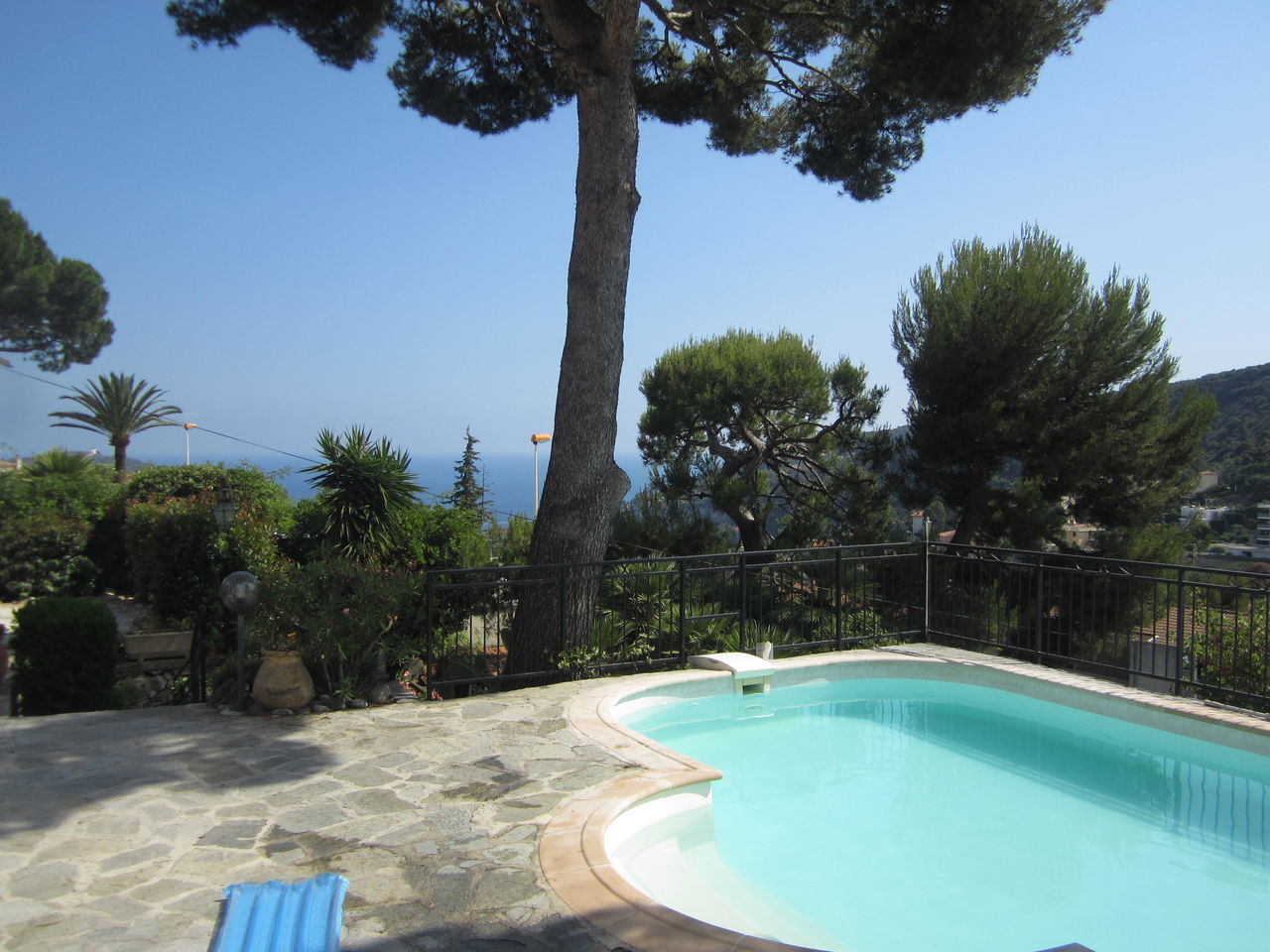 """View of the bay of Villefranche-sur-mer from a traditional villa on the Col de Villefranche (""""Villefranche hill""""). Villefranche is a small town situated between Nice and Monaco. Calm Côte D'Azur Day Europe Fresh Air Mediterranean  Nature Nice No People Outdoor Pool Outdoors Palm Tree Pine Tree Relaxation Room With A View Sky South Of France Summer Summer Views Swimming Pool Tranquility Tree Villa Villefranche Sur Mer Water"""
