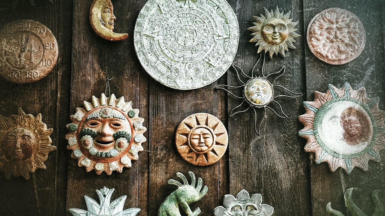 Here Comes The Sun Art Deco Suns All Around  On The Wall Outside Positive Energy  Makes You Warm Warmth Warmth Of The Sun Collection Dark Filter Sun Shines Sunshine You Are My Sunshine Wood Background Sun Moon And Stars