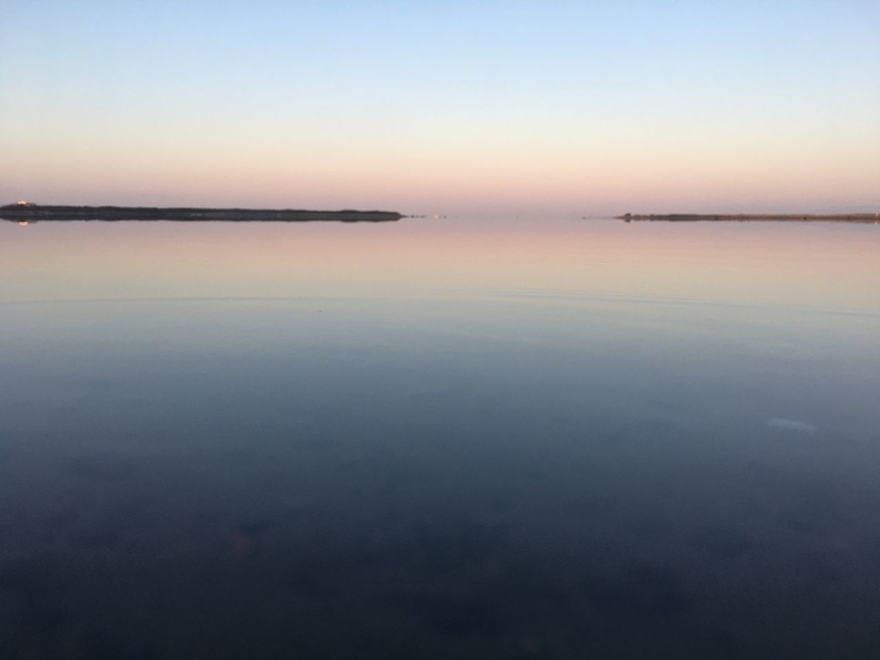 tranquility, tranquil scene, nature, beauty in nature, scenics, sunset, sky, idyllic, water, reflection, outdoors, waterfront, dusk, no people, sea, clear sky, landscape, horizon over water, day