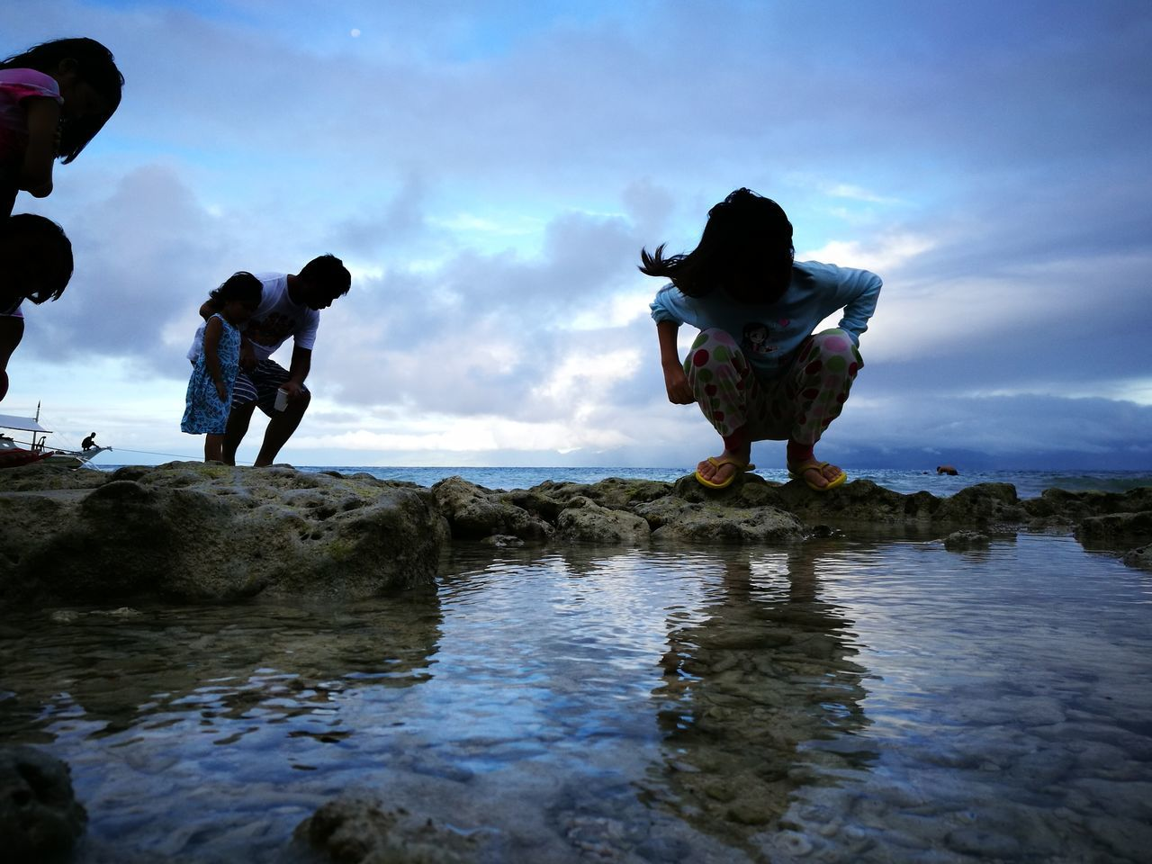 real people, childhood, water, full length, boys, standing, sky, girls, men, leisure activity, rear view, outdoors, cloud - sky, togetherness, day, lifestyles, friendship, nature, beauty in nature, people
