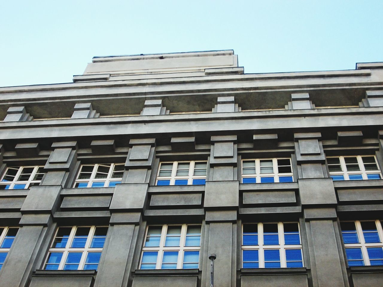 architecture, building exterior, window, built structure, low angle view, day, clear sky, no people, outdoors, blue, sky